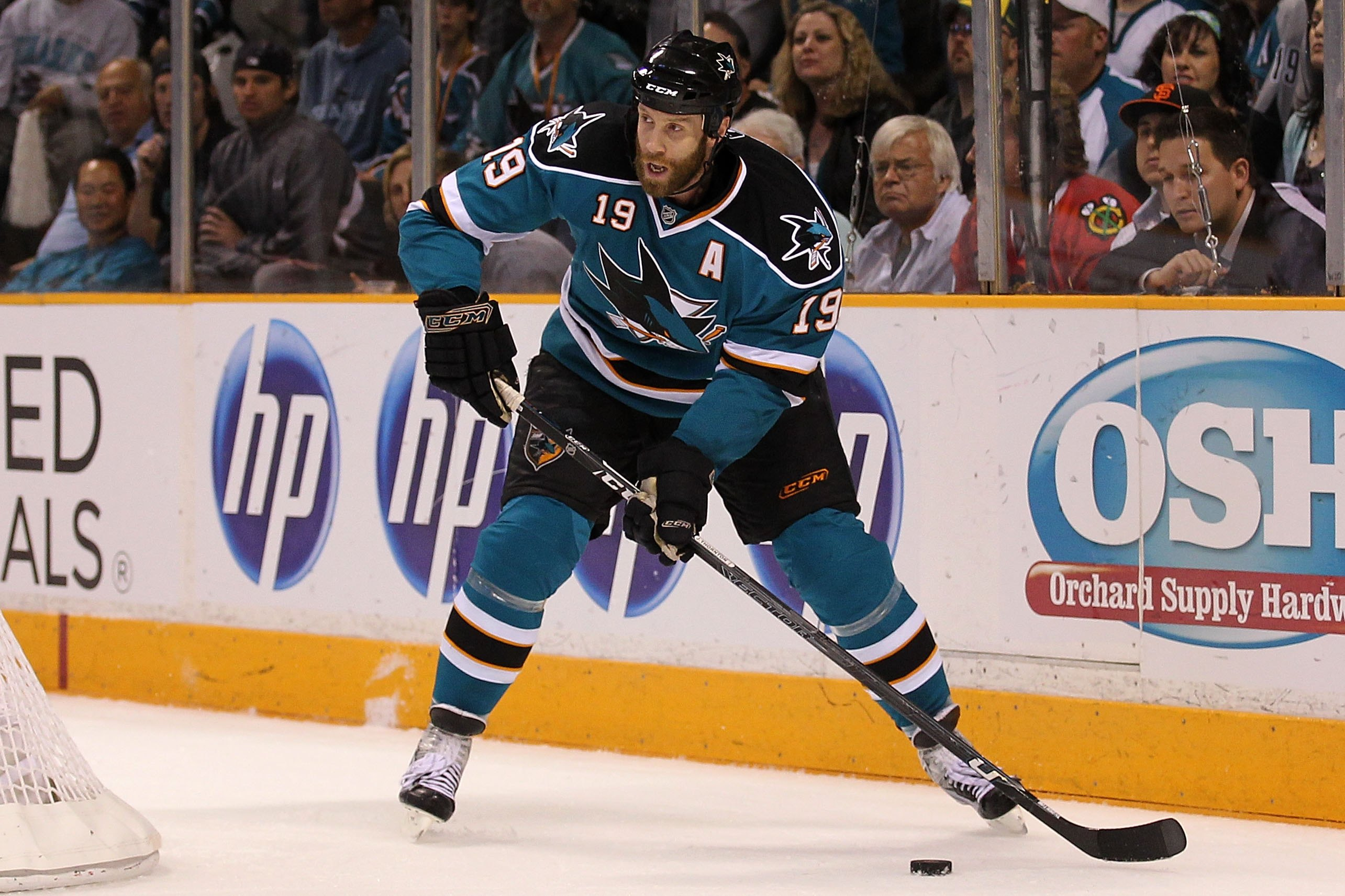 SAN JOSE, CA - MAY 18:  Joe Thornton #19 of the San Jose Sharks moves the puck while taking on the Chicago Blackhawks in Game Two of the Western Conference Finals during the 2010 NHL Stanley Cup Playoffs at HP Pavilion on May 18, 2010 in San Jose, Califor