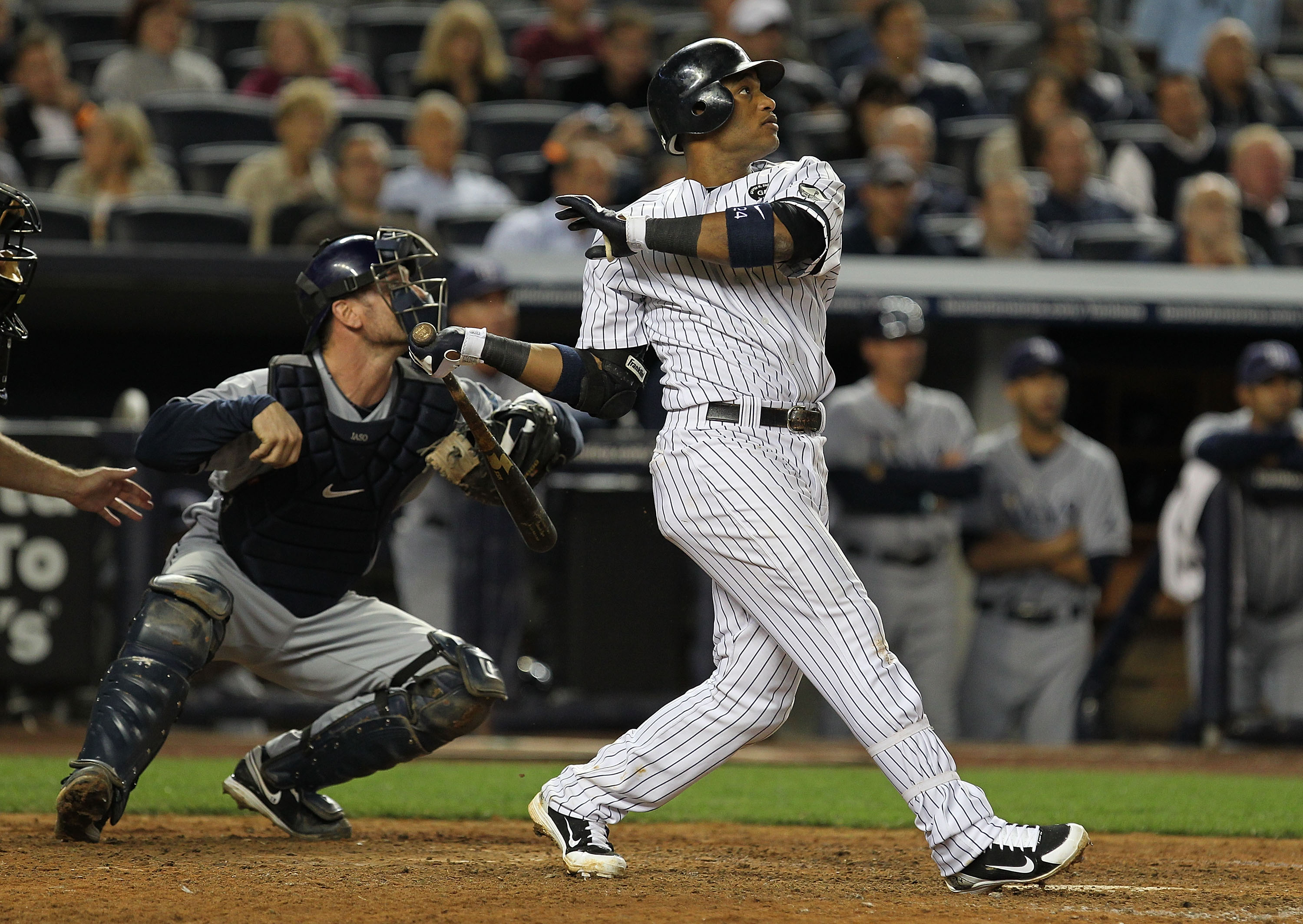 NEW YORK - SEPTEMBER 21:  Robinson Cano #24 of the New York Yankees drives in two runs with a double in the seventh inning against  the Tampa Bay Rays during their game on September 21, 2010 at Yankee Stadium in the Bronx borough of New York City.  (Photo