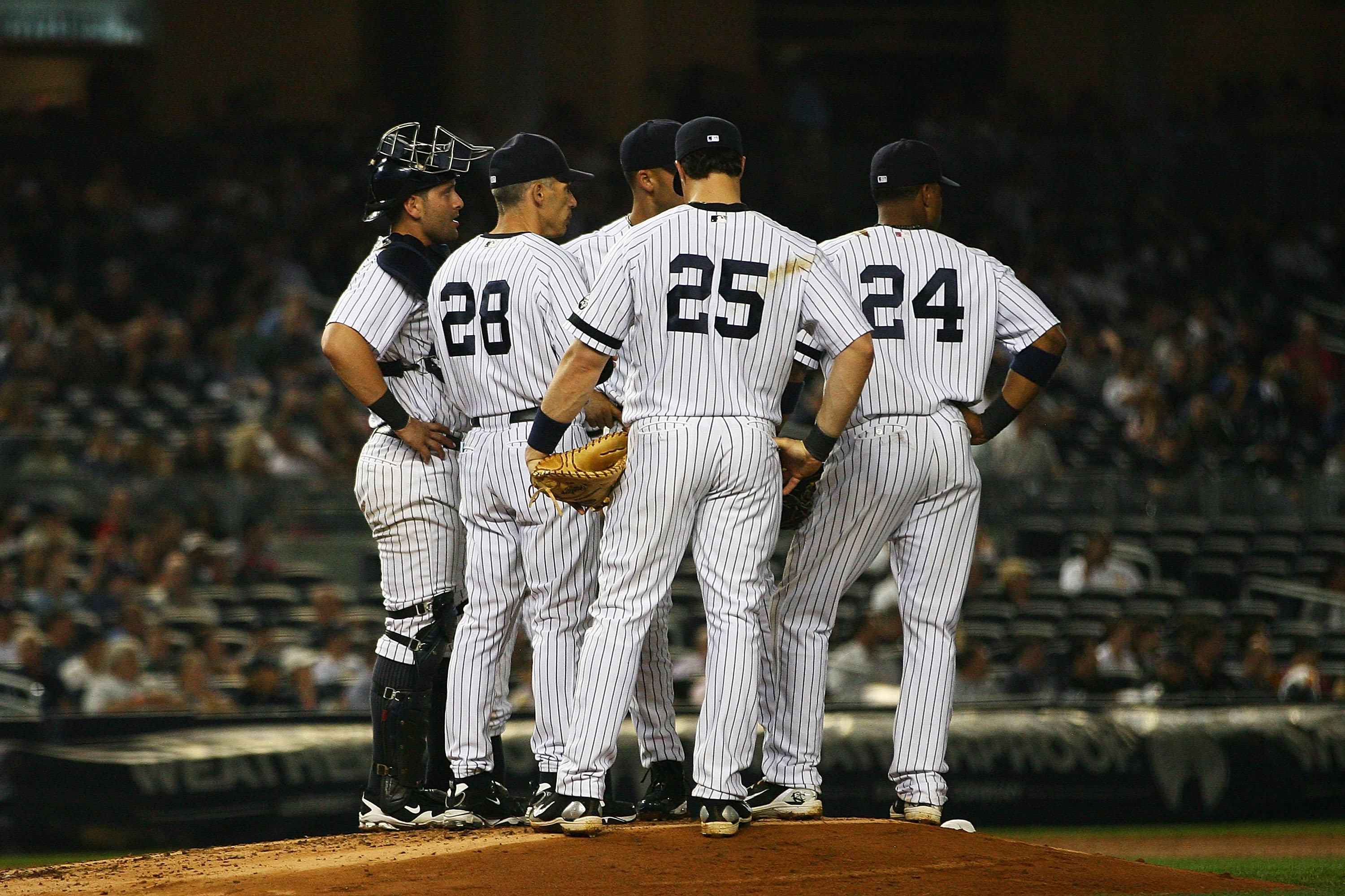 NEW YORK - SEPTEMBER 22:  The New York Yankees hold a team meeting on the mound during a game against the Tampa Bay Rays on September 22, 2010 at Yankee Stadium in the Bronx borough of New York City.  (Photo by Andrew Burton/Getty Images)