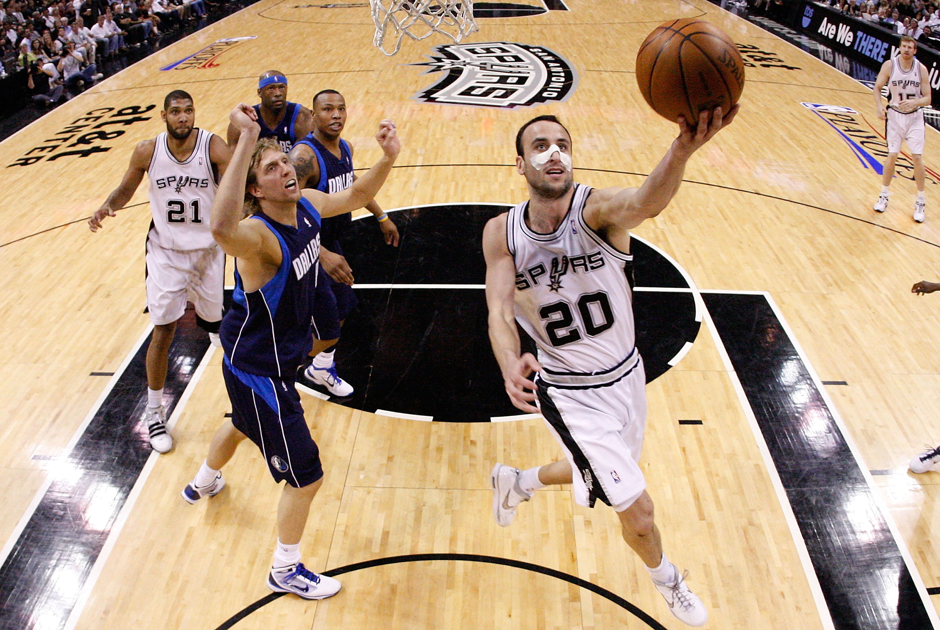 SAN ANTONIO - APRIL 29:  Guard Manu Ginobili #20 of the San Antonio Spurs takes a shot against Dirk Nowitzki #41 of the Dallas Mavericks in Game Six of the Western Conference Quarterfinals during the 2010 NBA Playoffs at AT&T Center on April 29, 2010 in S