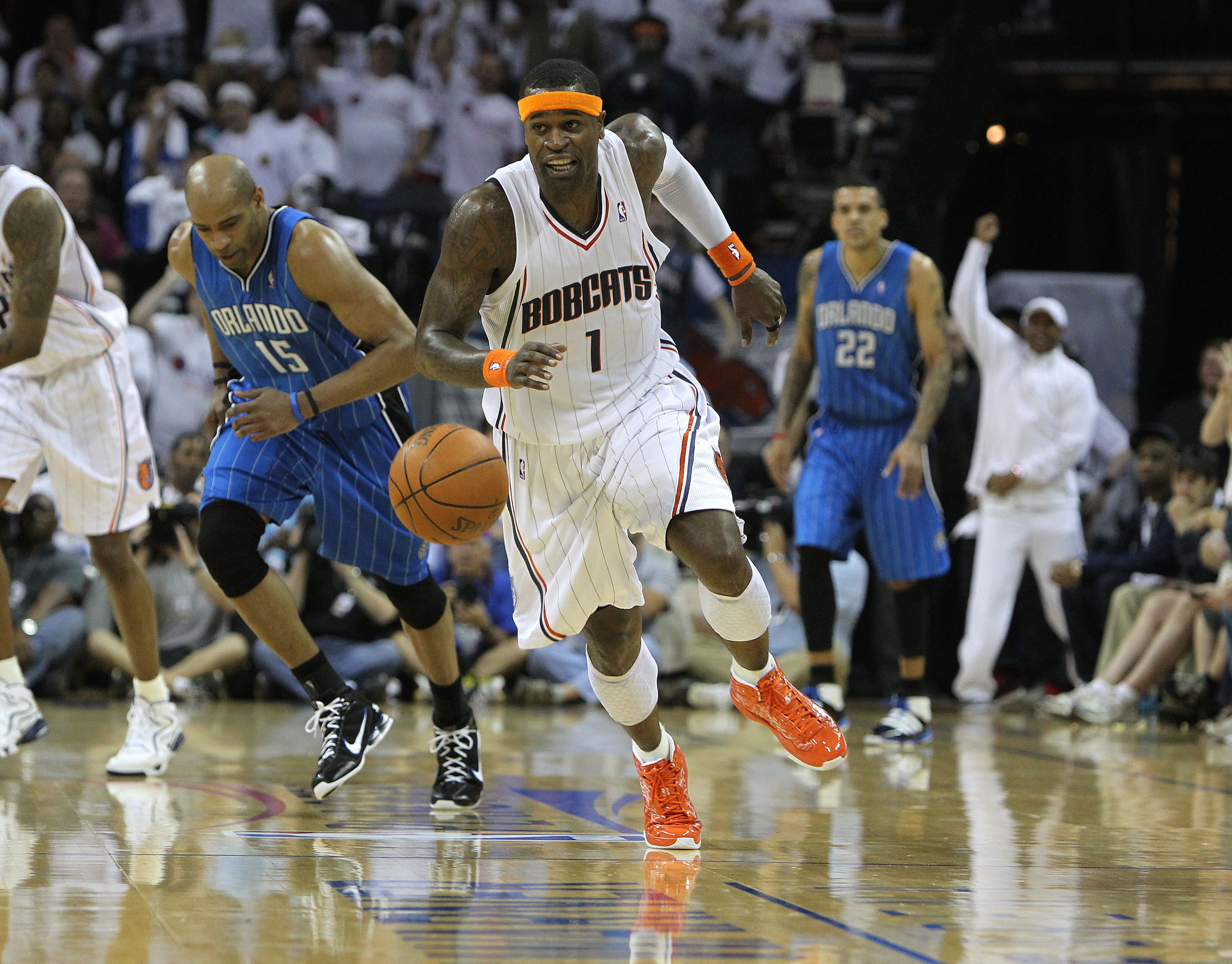 CHARLOTTE, NC - APRIL 24:  Guard Stephen Jackson #1 of the Charlotte Bobcats chases a loose ball while guard Vince Carter #15 of the Orlando Magic pursues during Game Three of the Eastern Conference Quarterfinals during the 2010 NBA Playoffs at Time Warne