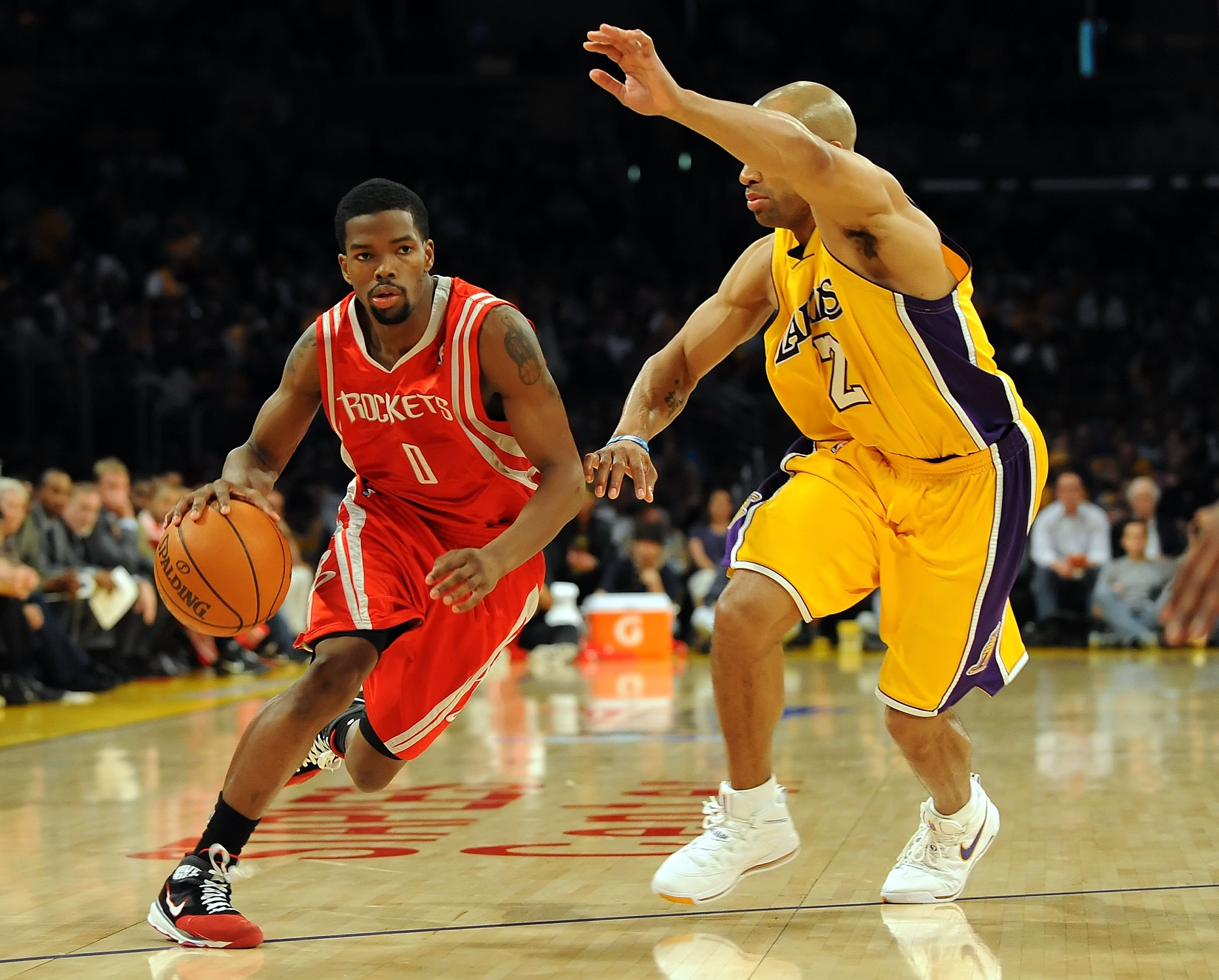 LOS ANGELES, CA - MAY 06:  Aaron Brooks #0 of the Houston Rockets moves the ball against Derek Fisher #2 of the Los Angeles Lakers in Game Two of the Western Conference Semifinals during the 2009 NBA Playoffs at Staples Center on May 6, 2009 in Los Angele