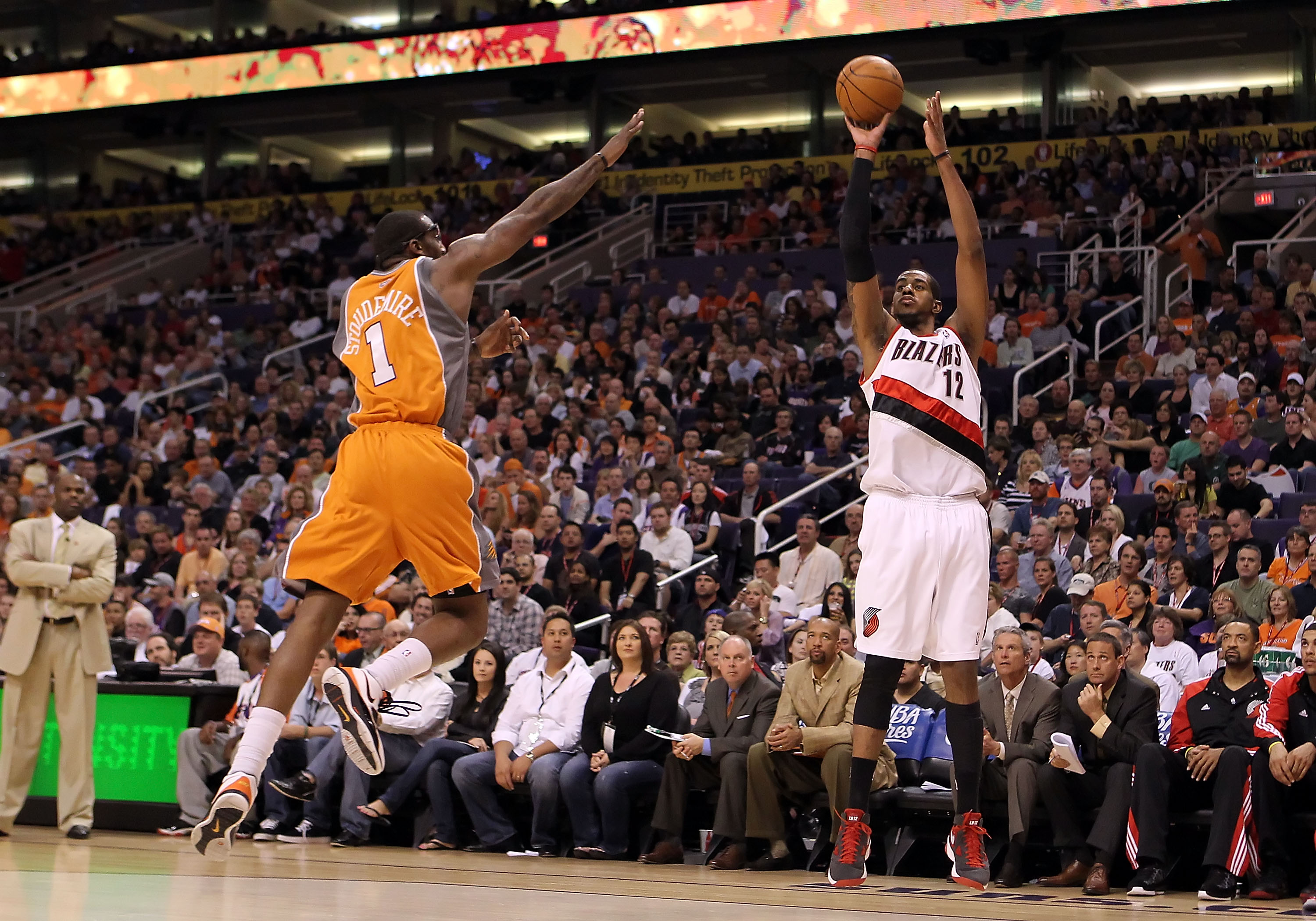 PHOENIX - MARCH 21:  LaMarcus Aldridge #12 of the Portland Trail Blazers puts up a three point shot over Amar'e Stoudemire #1 of the Phoenix Suns during the NBA game at US Airways Center on March 21, 2010 in Phoenix, Arizona. NOTE TO USER: User expressly