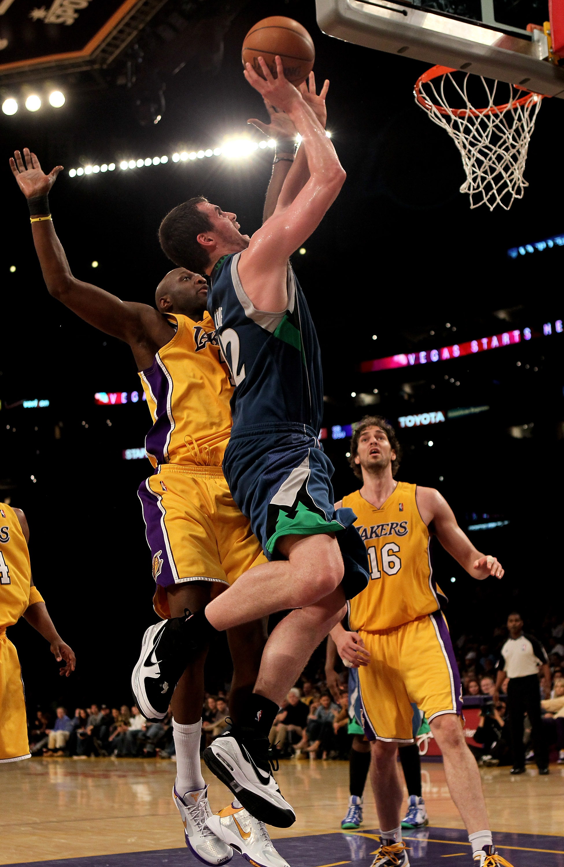 LOS ANGELES - MARCH 19:  Kevin LOve #42 of the Minnesota Timberwolves shoots over lamar Odom #7 of the Los Angeles Lakers on March 19, 2010 at Staples Center in Los Angeles, California.  The Lakeres won 104-96. NOTE TO USER: User expressly acknowledges an