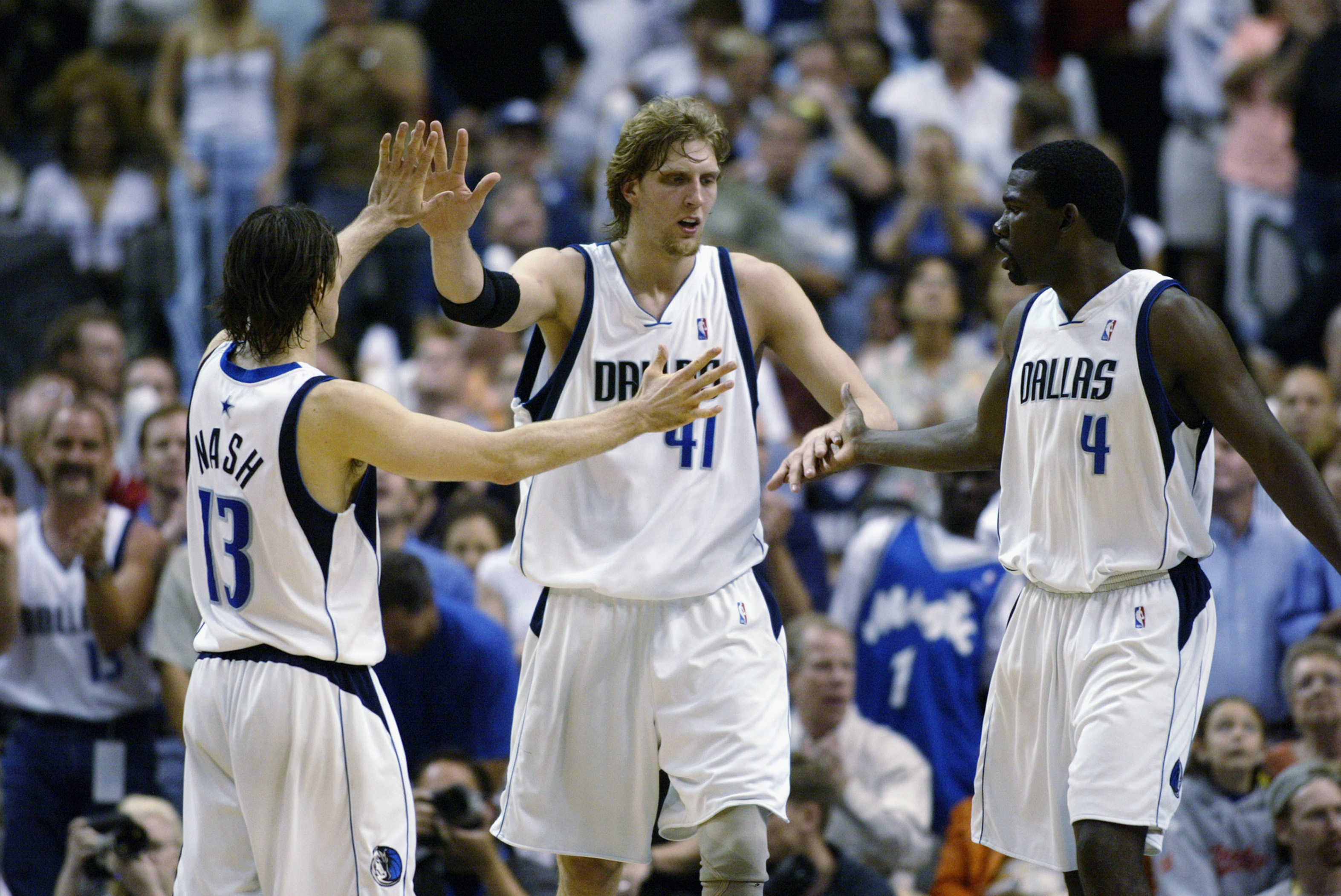 DALLAS - MAY 4:  (Left to Right) Steve Nash #13, Dirk Nowitzki #41, and Michael Finley #4 of the Dallas Mavericks celebrate in Game seven of the Western Conference Quarterfinals against the Portland Trail Blazers during the 2003 NBA Playoffs at American A