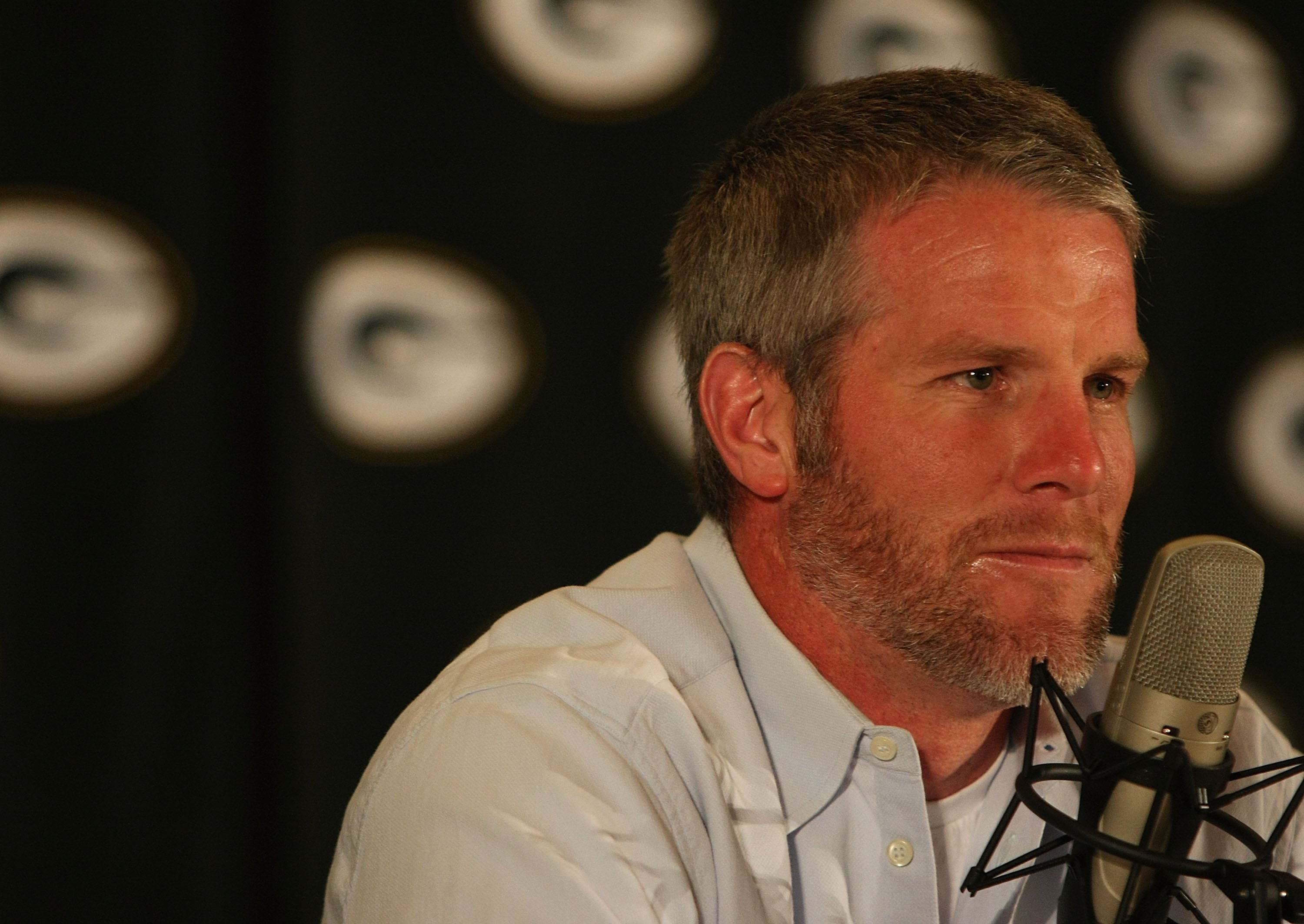 GREEN BAY, WI - MARCH 06: Quarterback Brett Favre of the Green Bay Packers listens to a question at his retirement press conference on March 6, 2008 at Lambeau Field in Green Bay, Wisconsin. (Photo by Jonathan Daniel/Getty Images)
