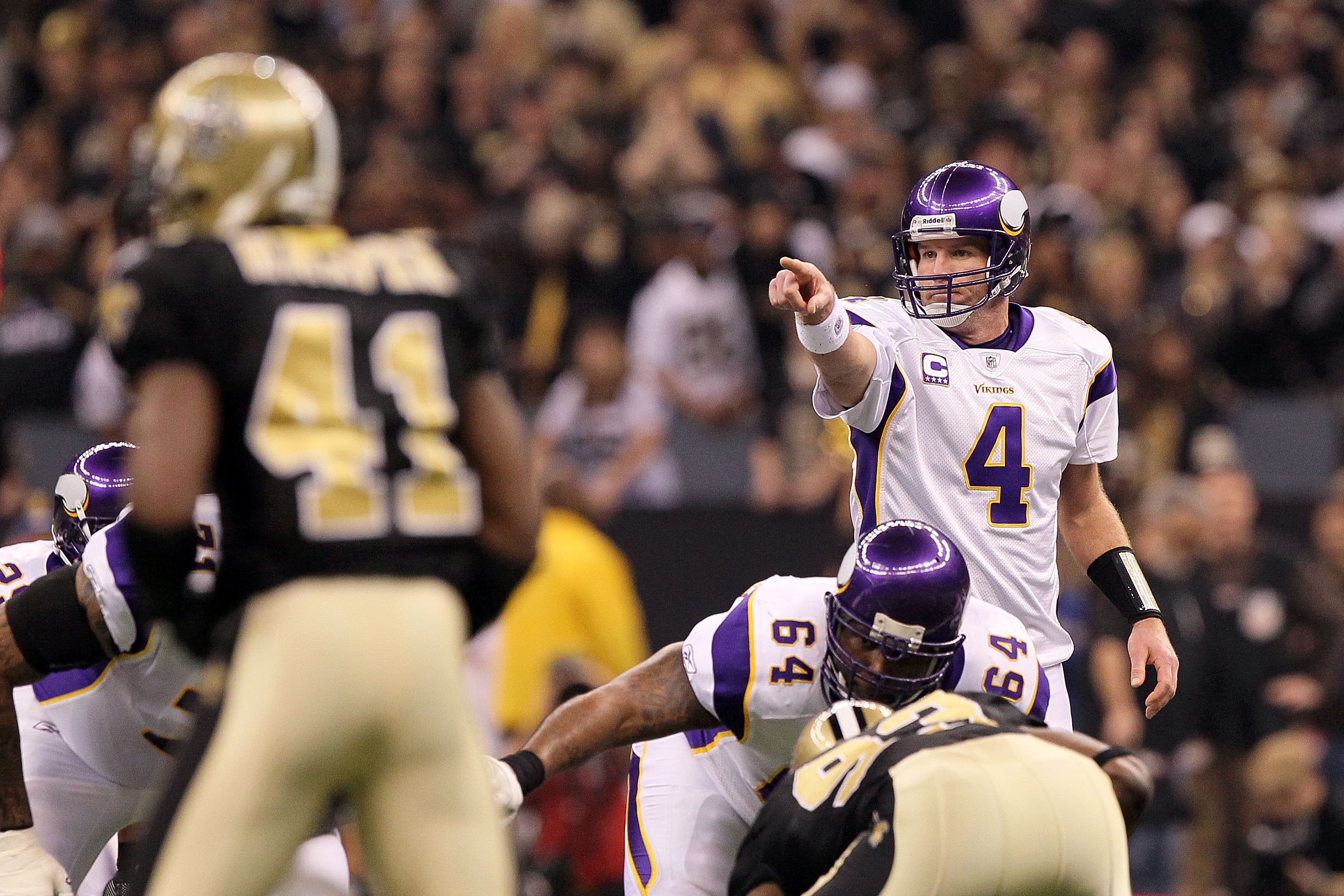 NEW ORLEANS - JANUARY 24:  Brett Favre #4 of the Minnesota Vikings gestures as he calls out signals in the shotgun formation against the New Orleans Saints during the NFC Championship Game at the Louisiana Superdome on January 24, 2010 in New Orleans, Lou