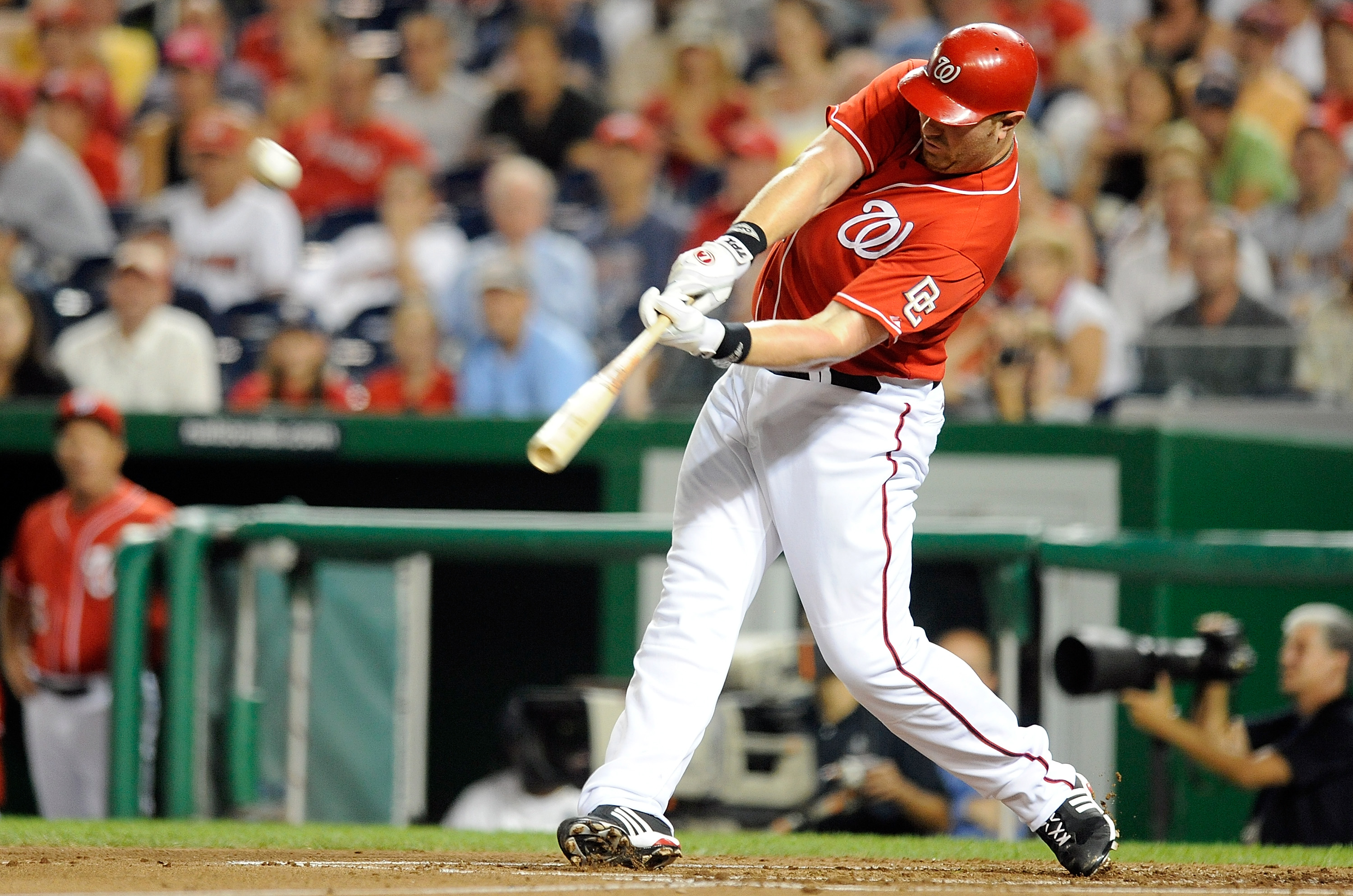 WASHINGTON - SEPTEMBER 24:  Adam Dunn #44 of the Washington Nationals hits a home run in the second inning against the Atlanta Braves at Nationals Park on September 24, 2010 in Washington, DC.  (Photo by Greg Fiume/Getty Images)