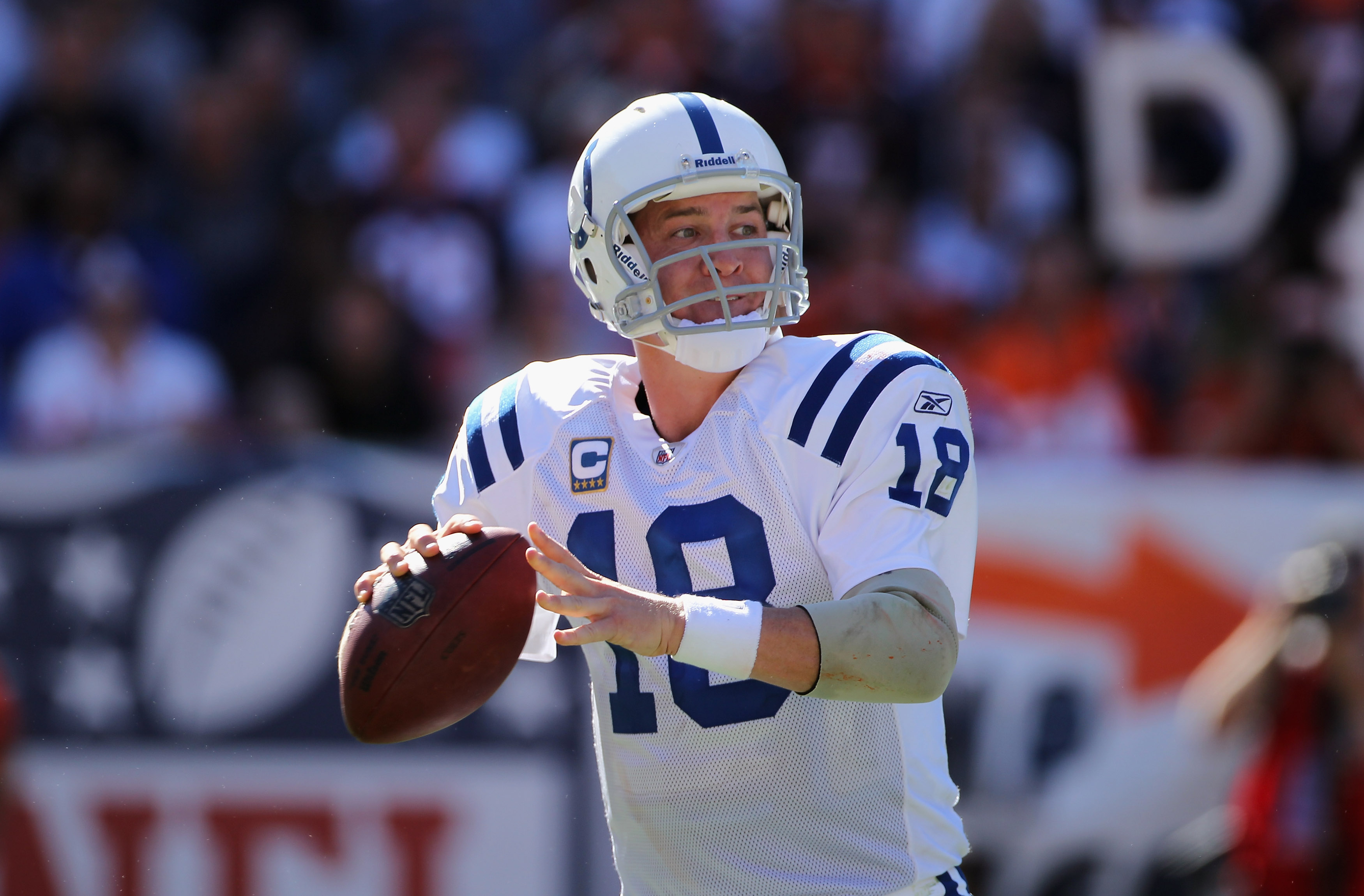 DENVER - SEPTEMBER 26:  Quarterback Peyton Manning #18 of the Indianapolis Colts drops back to pass against the Denver Broncos at INVESCO Field at Mile High on September 26, 2010 in Denver, Colorado.  (Photo by Doug Pensinger/Getty Images)
