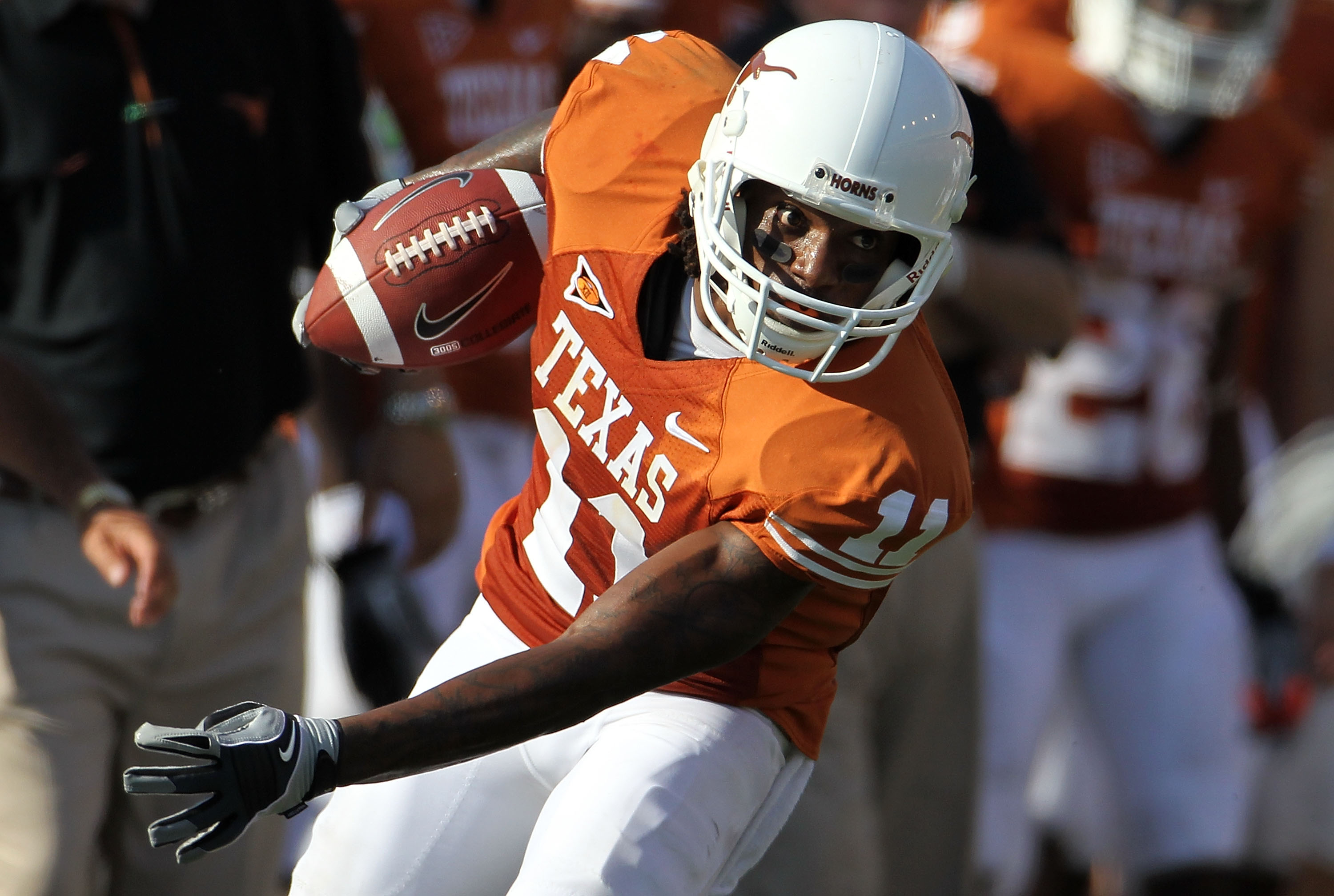 AUSTIN, TX - SEPTEMBER 25:  Wide receiver James Kirkendoll #11 of the Texas Longhorns runs the ball against the UCLA Bruins at Darrell K Royal-Texas Memorial Stadium on September 25, 2010 in Austin, Texas.  (Photo by Ronald Martinez/Getty Images)