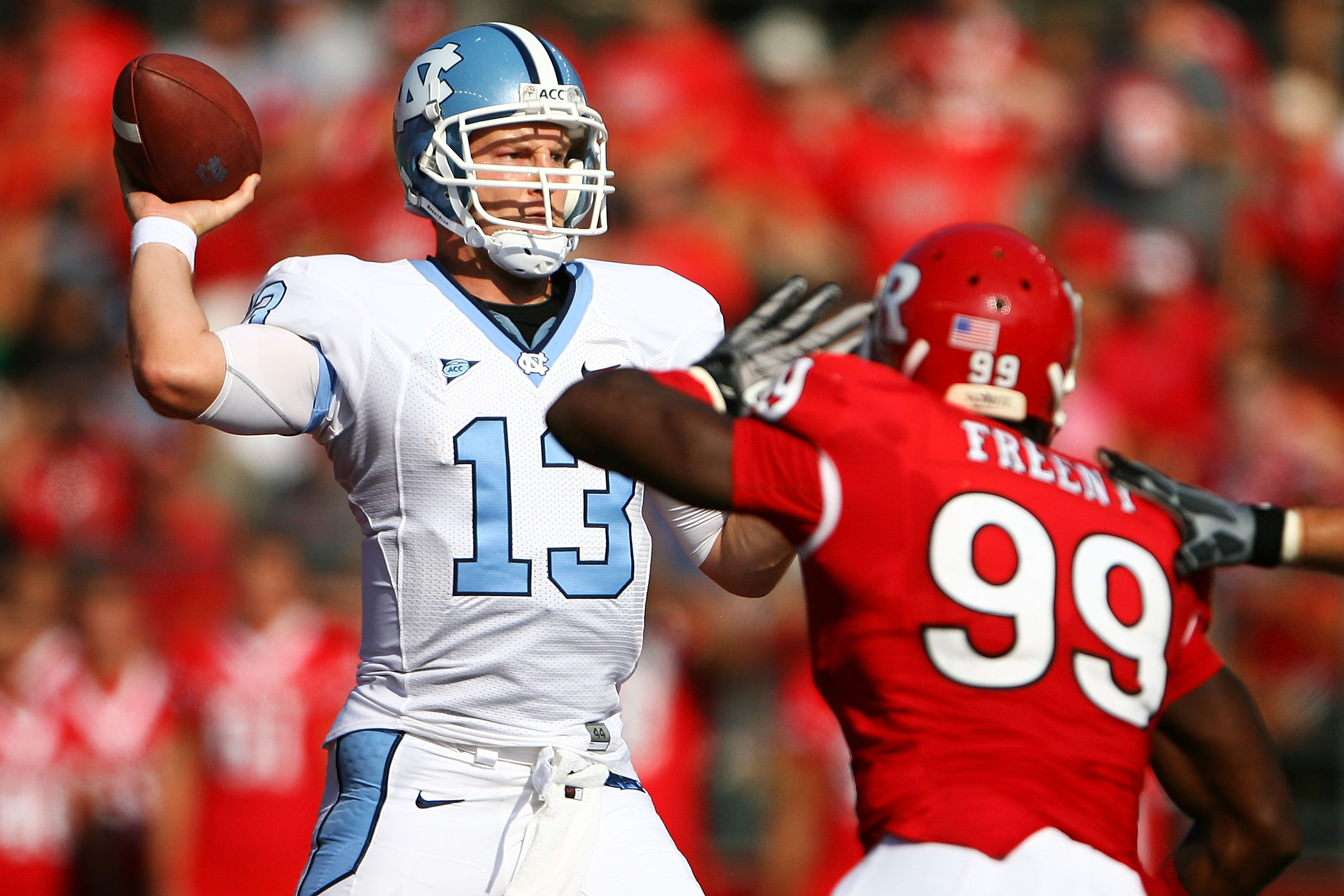 NEW BRUNSWICK, NJ - SEPTEMBER 25: Jonathan Freeny #99 of the Rutgers Scarlet Knights attempts to block a pass from  T.J. Yates #13 of the North Carolina Tar Heels during a game at Rutgers Stadium on September 25, 2010 in New Brunswick, New Jersey.  (Photo