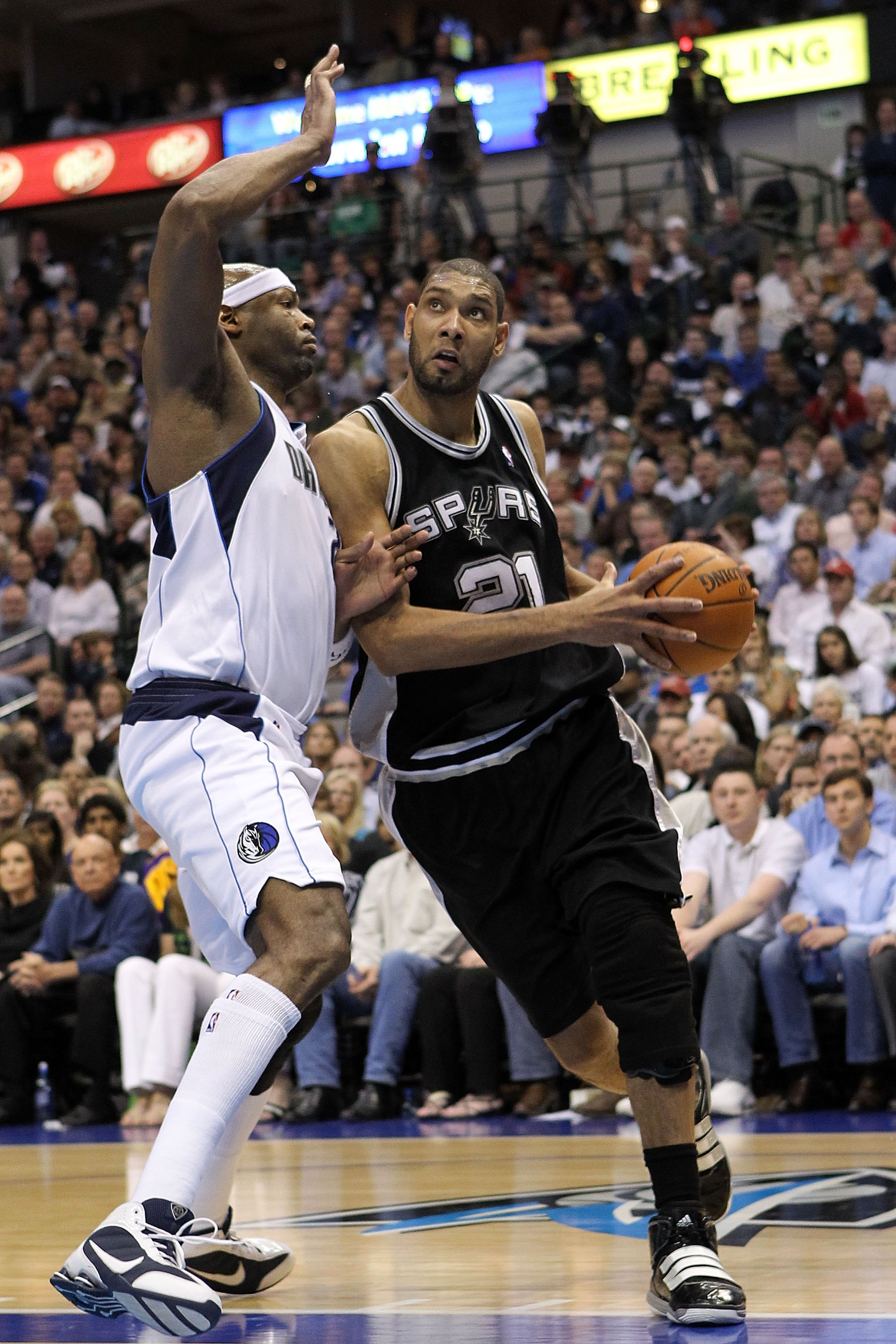 DALLAS - APRIL 18:  Forward Tim Duncan #21 of the San Antonio Spurs dribbles the ball against Erick Dampier #25 of the Dallas Mavericks in Game One of the Western Conference Quarterfinals during the 2010 NBA Playoffs at American Airlines Center on April 1