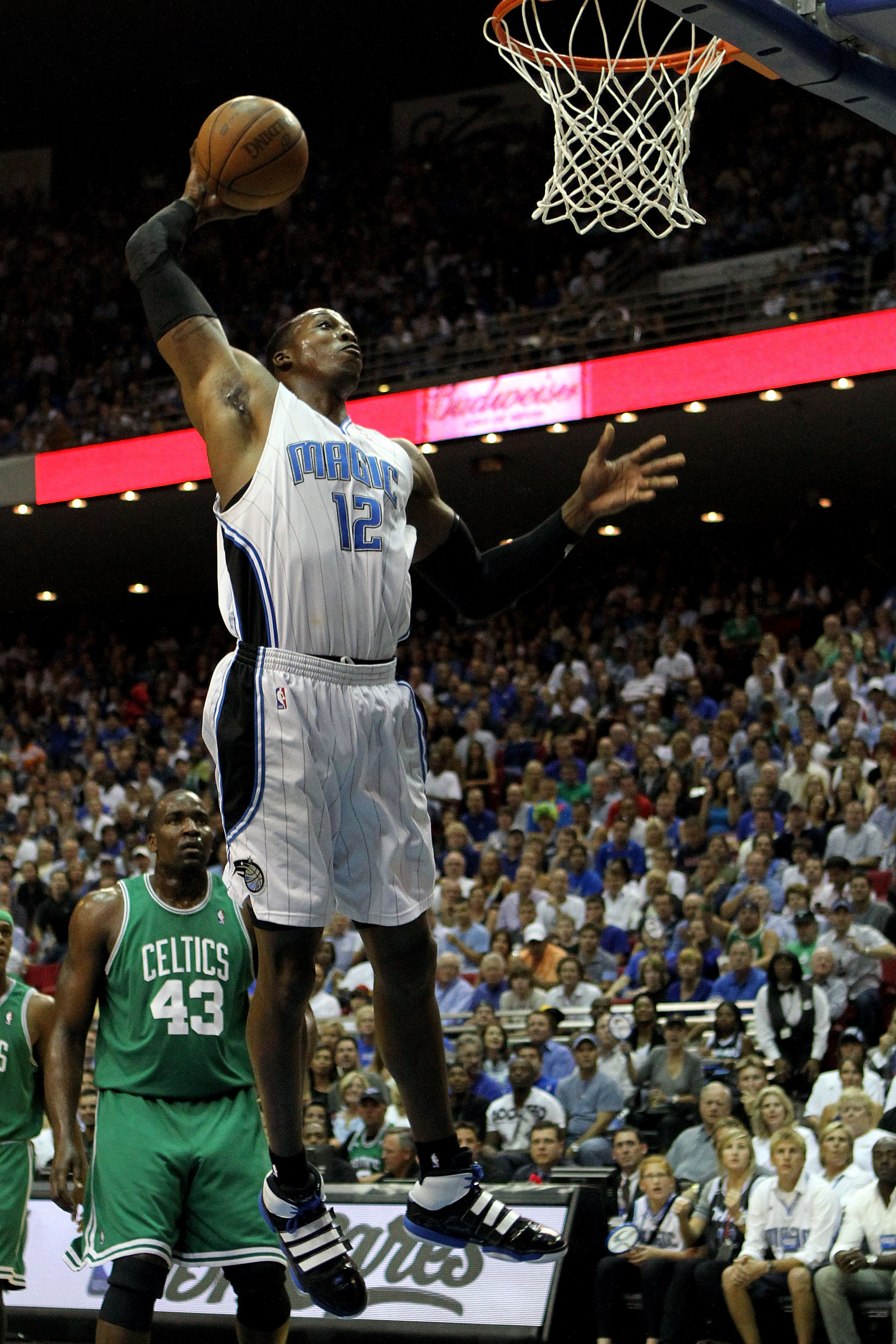 ORLANDO, FL - MAY 26:  Dwight Howard #12 of the Orlando Magic dunks against the Boston Celtics in Game Five of the Eastern Conference Finals during the 2010 NBA Playoffs at Amway Arena on May 26, 2010 in Orlando, Florida.  NOTE TO USER: User expressly ack