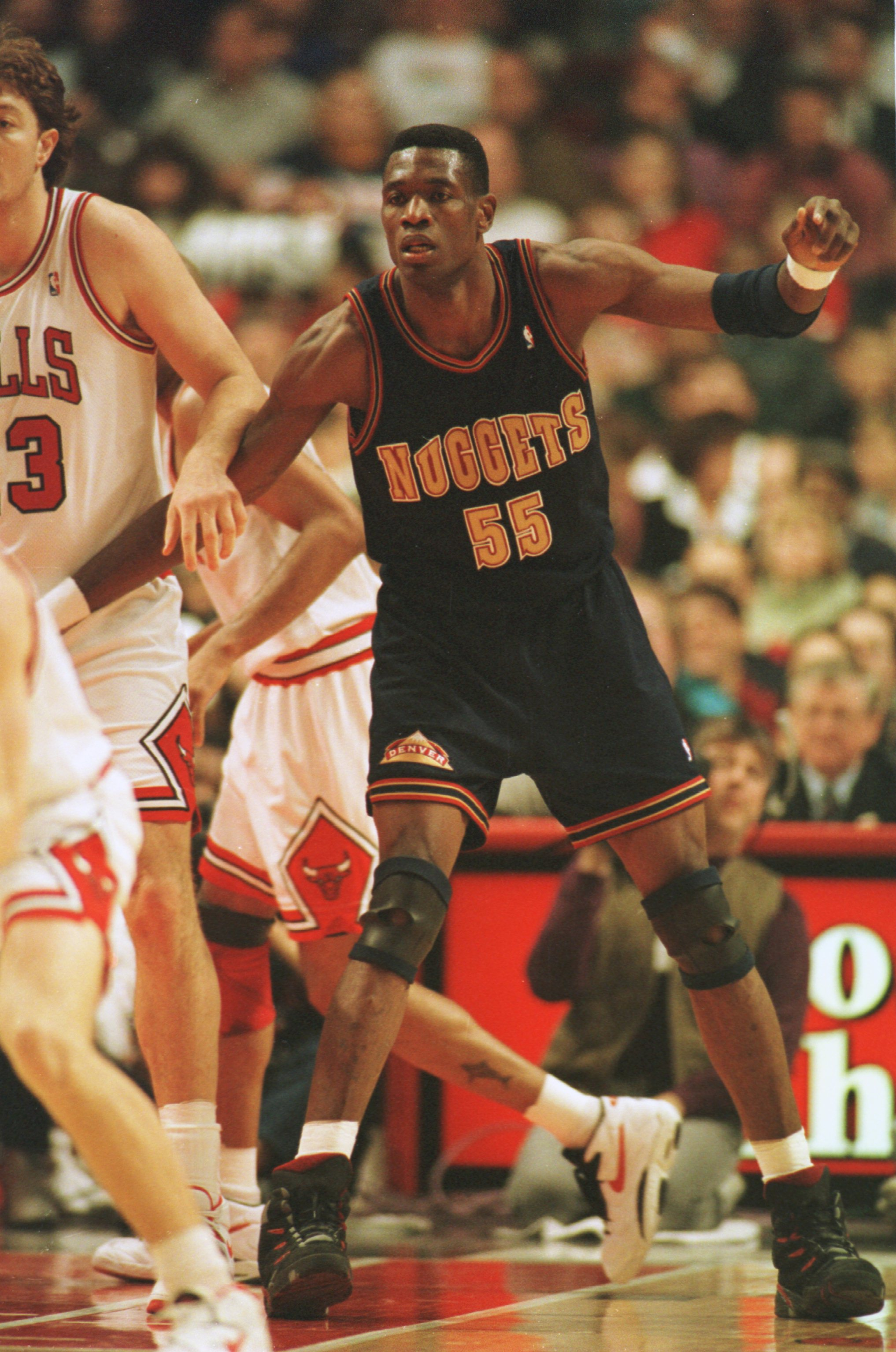 4 Jan 1995:  Center Dikembe Mutombo #55 of the Denver Nuggets battles with a defender from  the Chicago Bulls for position during the Nuggets 86-80 loss to the Bulls at the United Center in Chicago, Illinois.   Mandatory Credit: Jonathan Daniel/ALLSPORT
