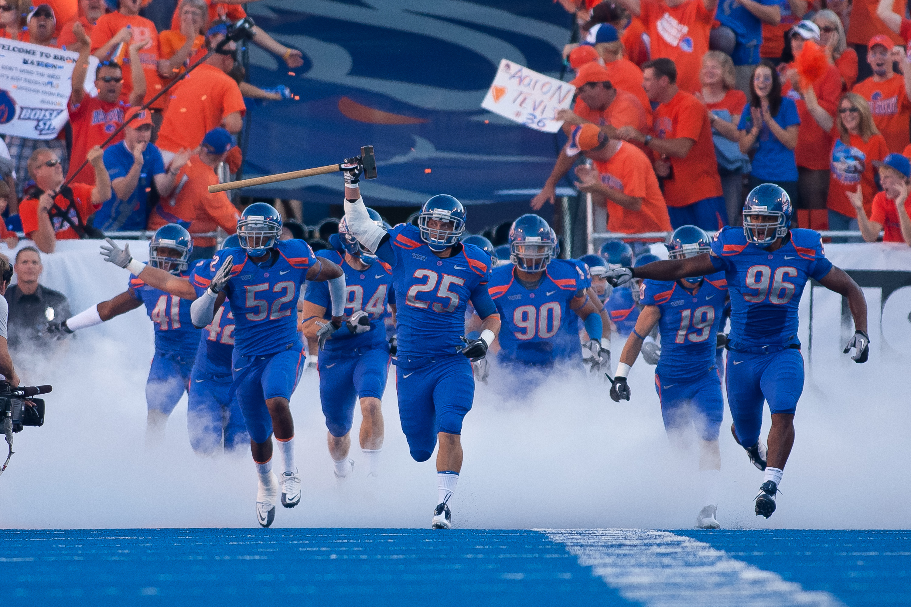 BOISE, ID - SEPTEMBER 25:  Linebacker Billy Derome #25 of the Boise State Broncos leads his team onto the field before the game against the Oregon State Beavers at Bronco Stadium on September 25, 2010 in Boise, Idaho.  (Photo by Otto Kitsinger III/Getty I