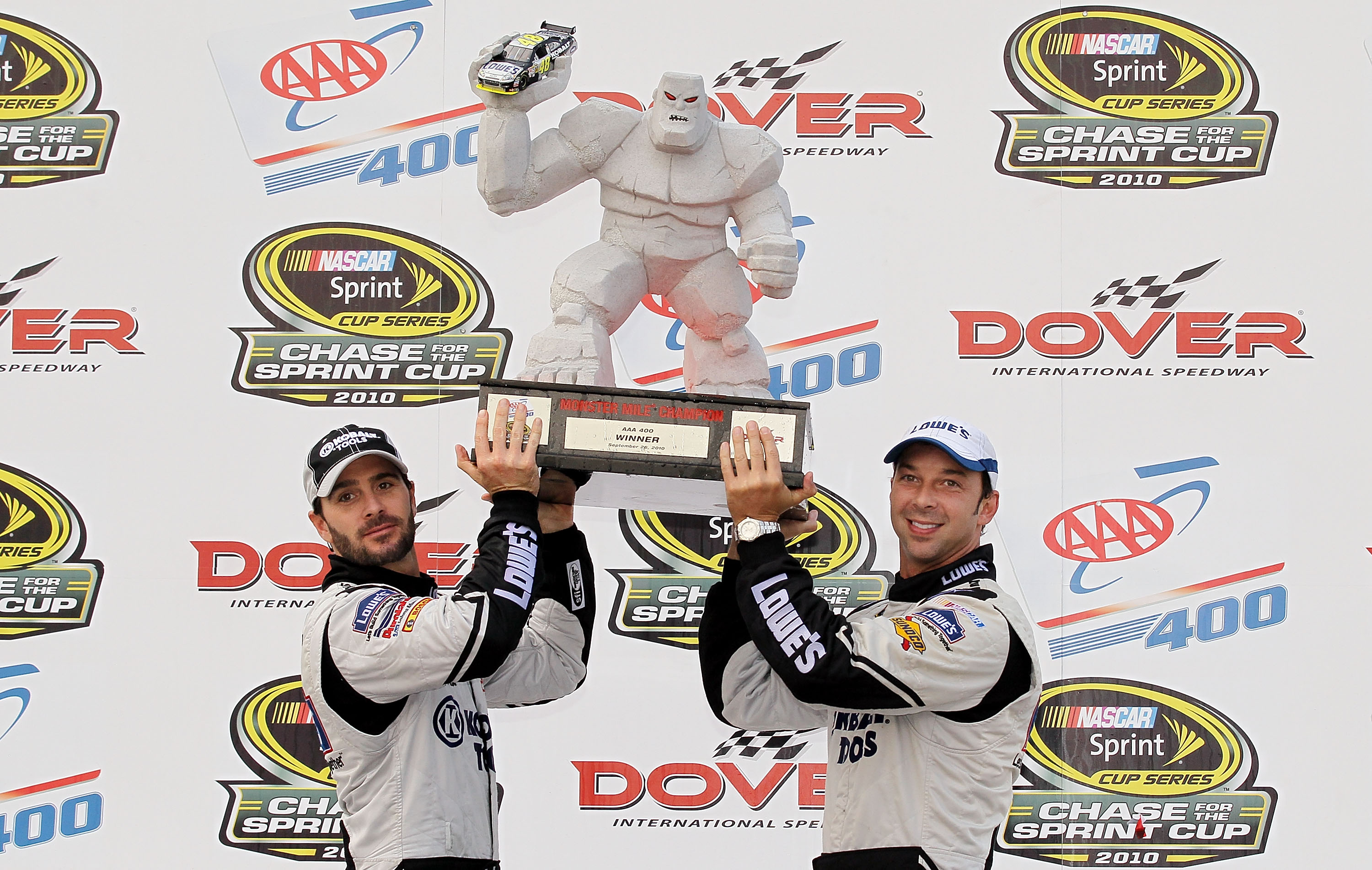 DOVER, DE - SEPTEMBER 26:  Jimmie Johnson (L), driver of the #48 Lowe's Chevrolet, and crew chief Chad Knaus celebrate in Victory Lane after winning the NASCAR Sprint Cup Series AAA 400 at Dover International Speedway on September 26, 2010 in Dover, Delaw
