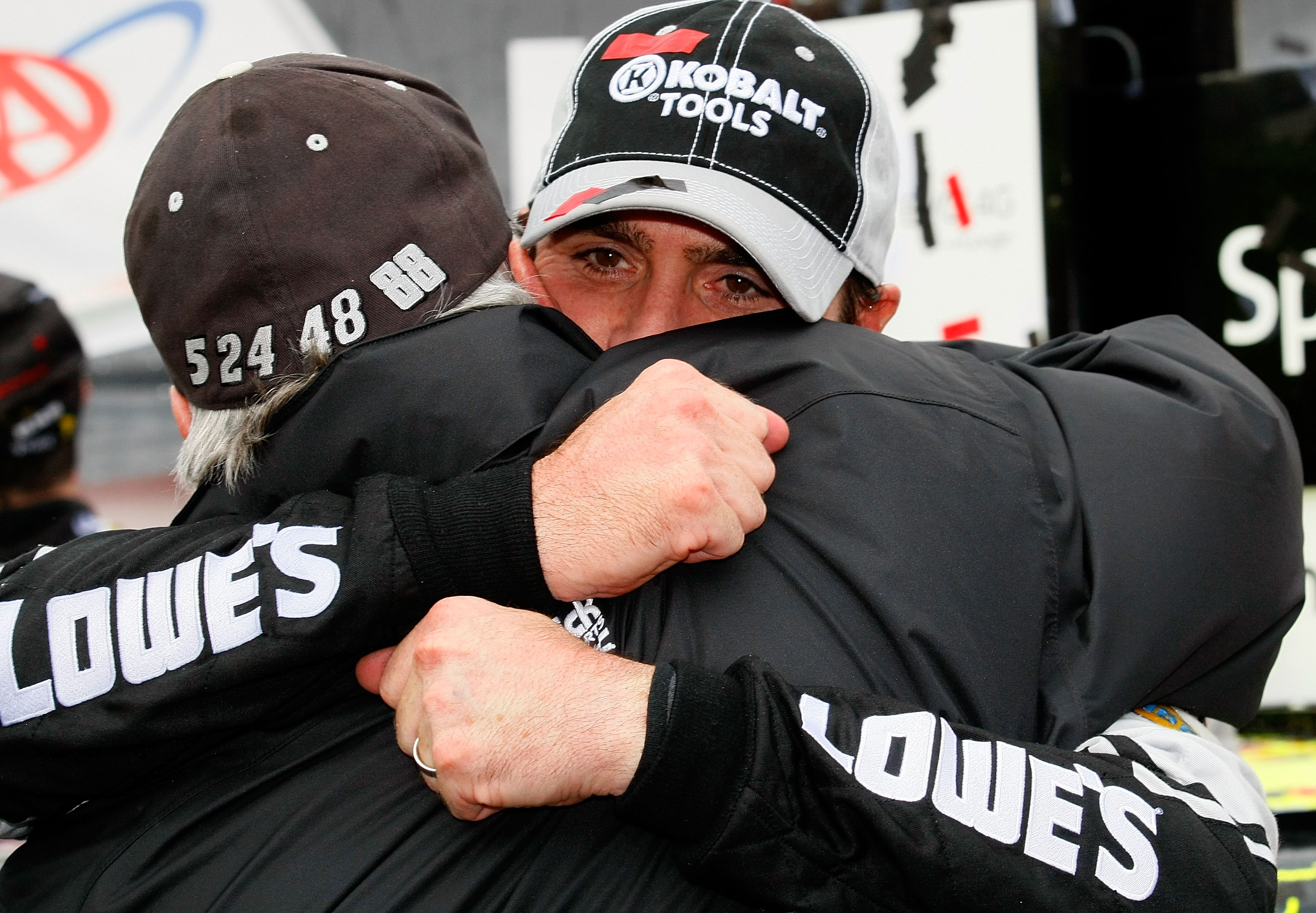 DOVER, DE - SEPTEMBER 26:  Jimmie Johnson (R), driver of the #48 Lowe's Chevrolet, hugs team owner Rick Hendrick in Victory Lane after winning the NASCAR Sprint Cup Series AAA 400 at Dover International Speedway on September 26, 2010 in Dover, Delaware.