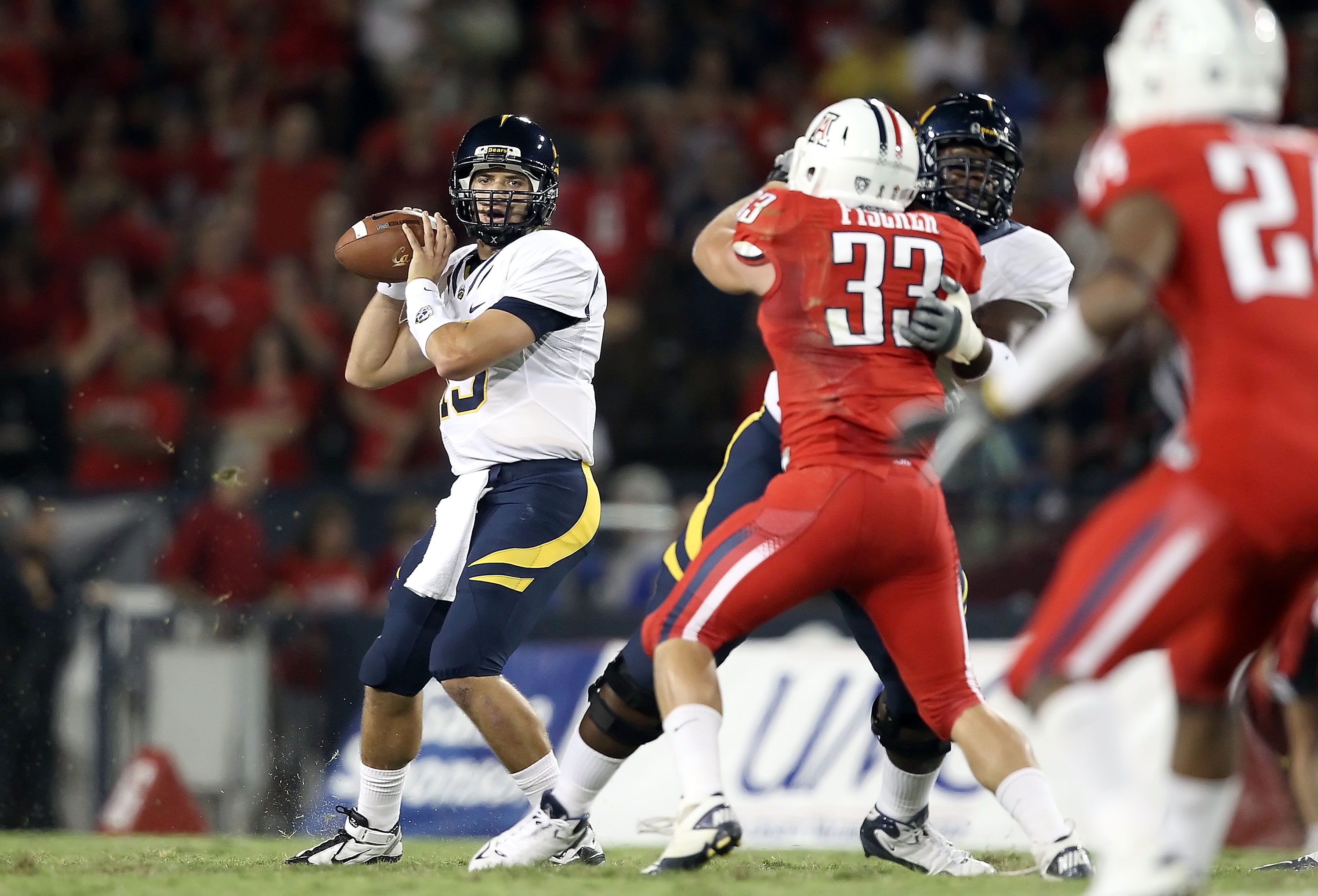 TUCSON, AZ - SEPTEMBER 25:  Quarterback Kevin Riley #13 of the California Bears drops back to pass during the college football game against the Arizona Wildcats at Arizona Stadium on September 25, 2010 in Tucson, Arizona.  (Photo by Christian Petersen/Get