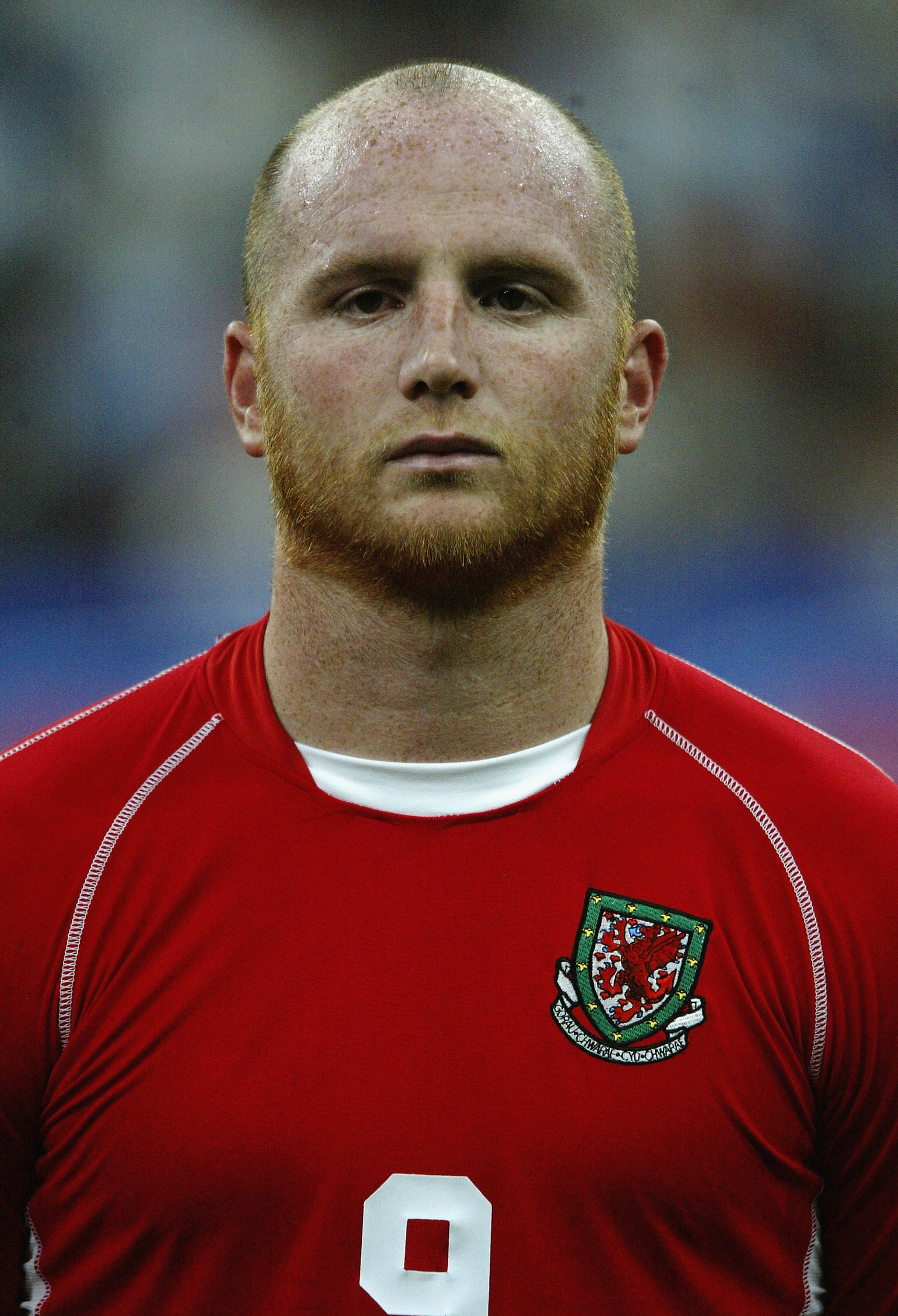 MILAN - SEPTEMBER 6:  John Hartson of Wales during the team line-up during the Euro 2004 Qualifying Group 9 match between Italy and Wales on September 6, 2003 at the San Siro in Milan, Italy.  Italy won the match 4-0.  (Photo by Mark Thompson/Getty Images