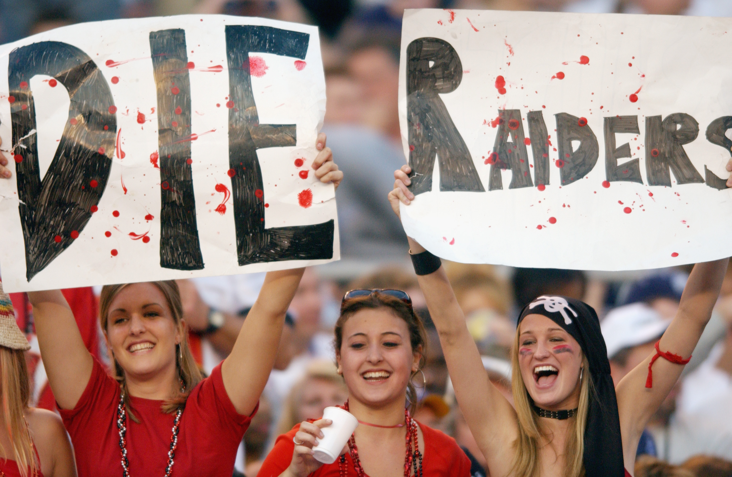 SAN DIEGO - JANUARY 26:  Three female fans of the Tampa Bay Buccaneers show their hate for the Oakland Raiders during Super Bowl XXXVII on January 26, 2003 at Qualcomm Stadium in San Diego, California. The Buccaneers defeated the Raiders 48-21. (Photo by