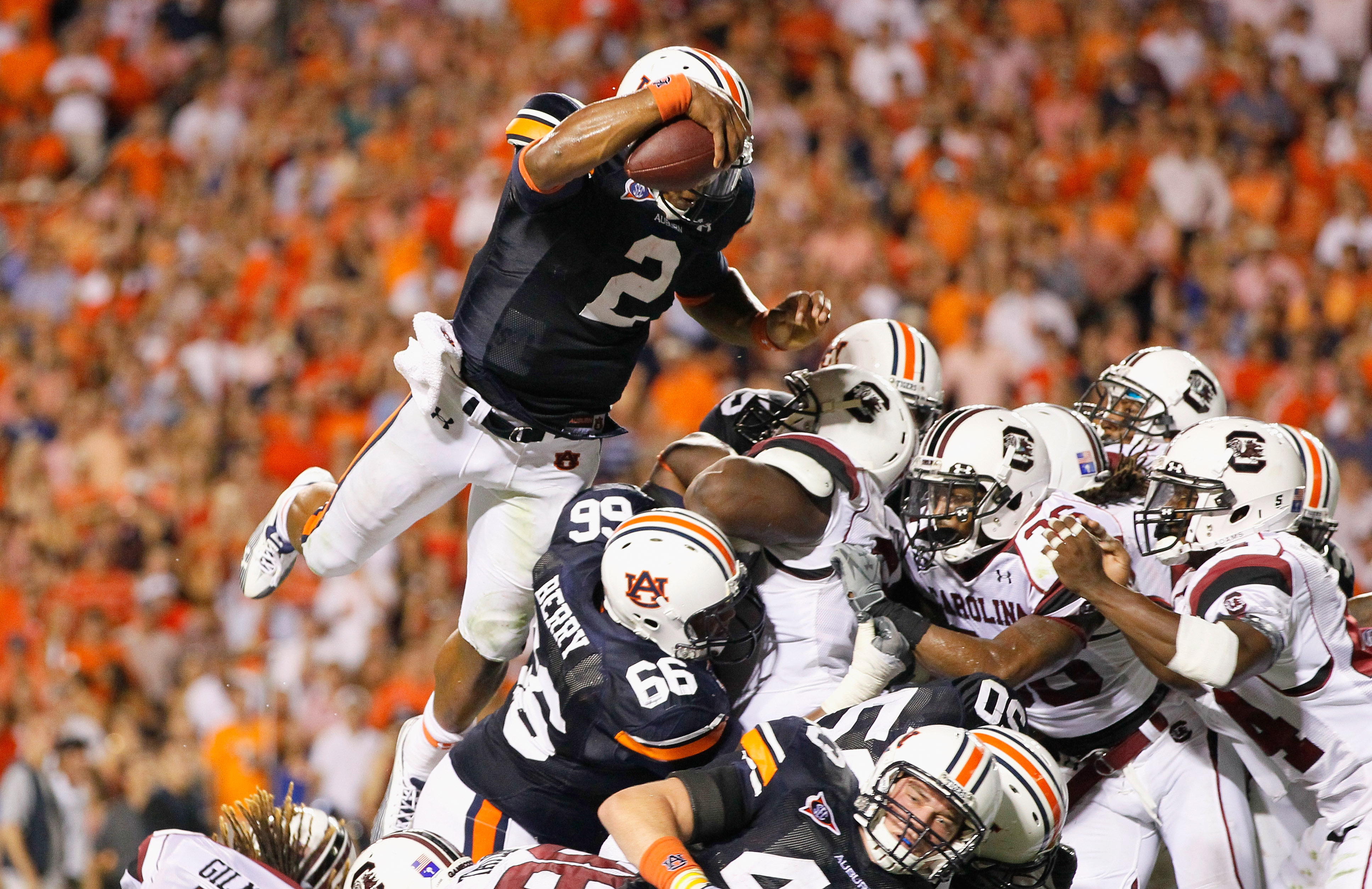 AUBURN, AL - SEPTEMBER 25:  Quarterback Cameron Newton #2 of the Auburn Tigers dives across the offensive and defensive lines for a touchdown against the South Carolina Gamecocks before it was called back for a false start at Jordan-Hare Stadium on Septem