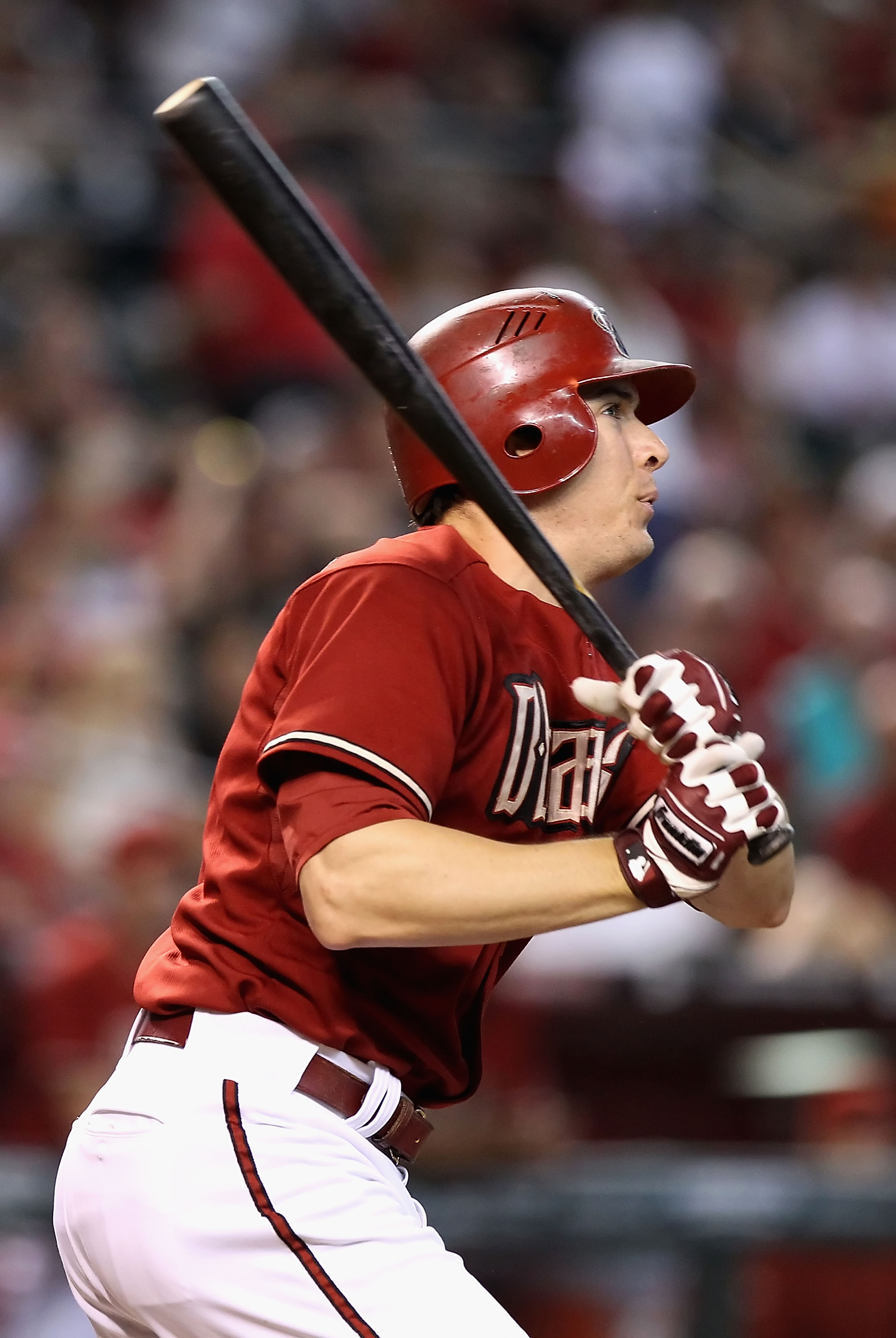 PHOENIX - SEPTEMBER 06:  Kelly Johnson #2 of the Arizona Diamondbacks hits a single against the San Francisco Giants during the Major League Baseball game at Chase Field on September 6, 2010 in Phoenix, Arizona.  (Photo by Christian Petersen/Getty Images)
