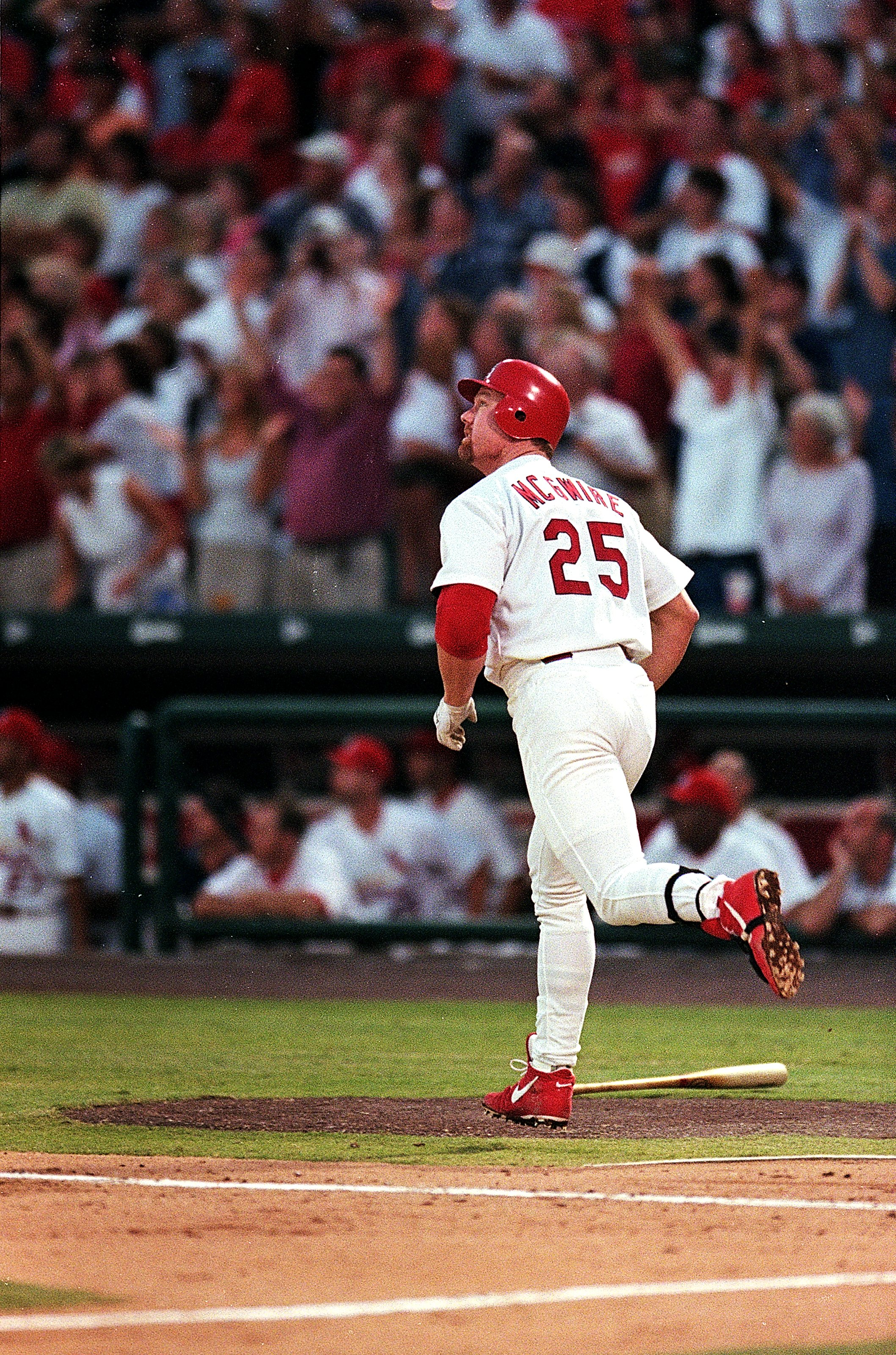 5 Aug 1999:  Mark McGwire #25 of the St. Louis Cardinals runs after he hits his 500th home run during the game against San Diego Padres at Busch Stadium in St. Louis, Missouri. The Padres defeated the Cardinals 10-3. Mandatory Credit: Elsa Hasch  /Allspor