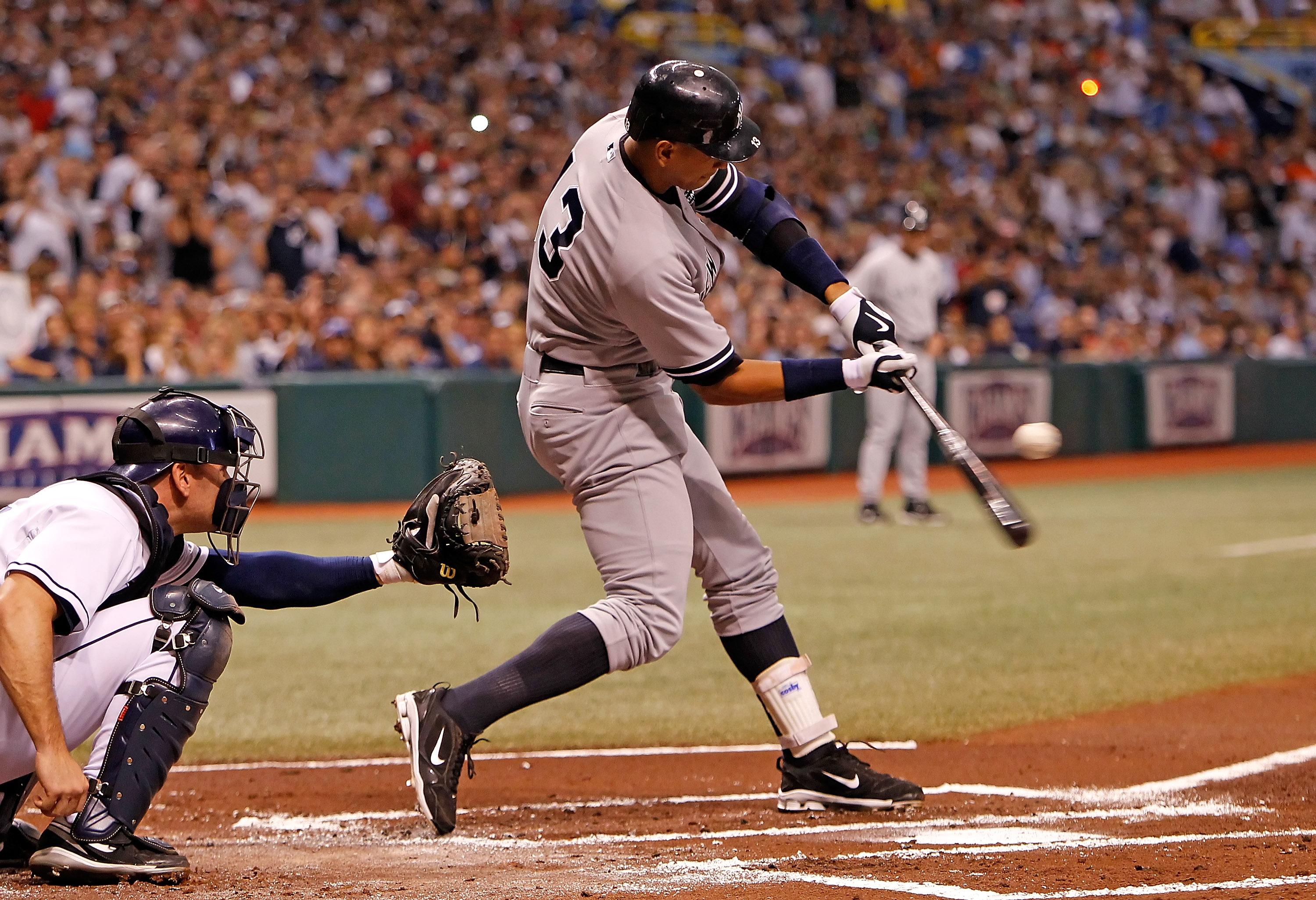ST PETERSBURG, FL - JULY 30:  Infielder Alex Rodriguez #13 of the New York Yankees fouls off a pitch against the Tampa Bay Rays during the game at Tropicana Field on July 30, 2010 in St. Petersburg, Florida.  (Photo by J. Meric/Getty Images)
