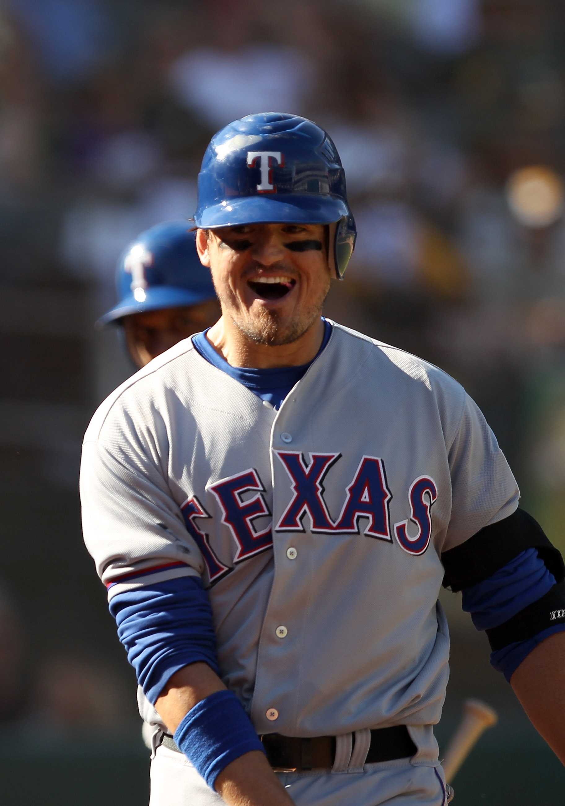 OAKLAND, CA - SEPTEMBER 25:  Jorge Cantu #8 of the Texas Rangers celebrates after he hit the game winning home run against the Oakland Athletics at the Oakland-Alameda County Coliseum on September 25, 2010 in Oakland, California. The Rangers clinched the