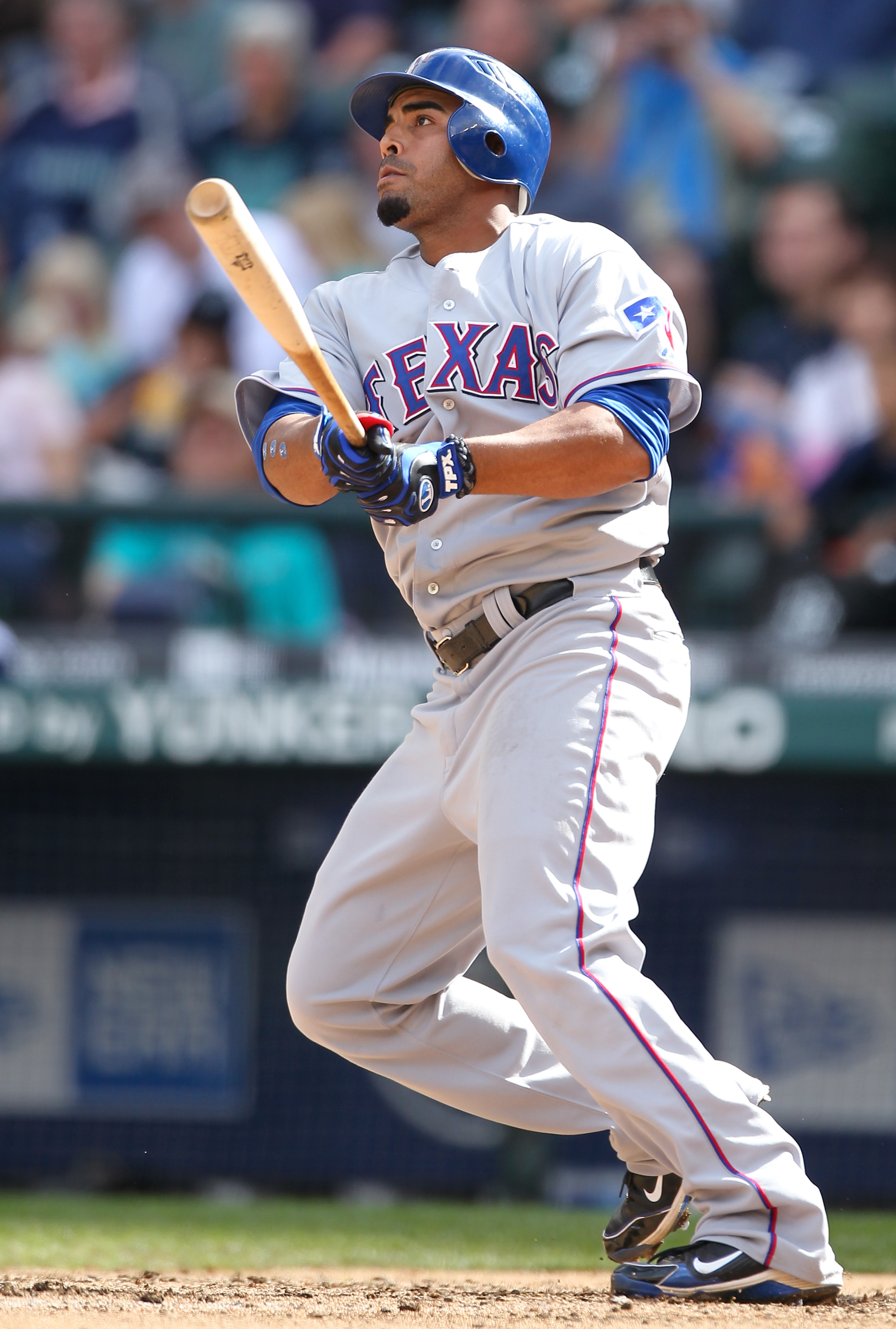 SEATTLE - SEPTEMBER 19:  Nelson Cruz #17 of the Texas Rangers watches the flight of his solo home run against the Seattle Mariners at Safeco Field on September 19, 2010 in Seattle, Washington. The Mariners defeated the Rangers 2-1. (Photo by Otto Greule J