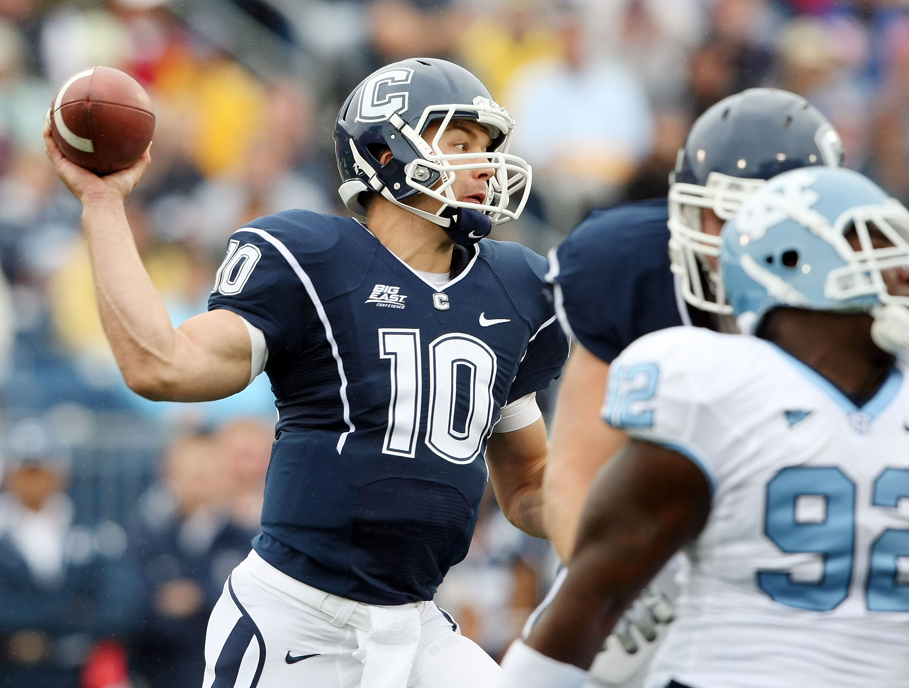 EAST HARTFORD, CT - SEPTEMBER 12:  Zach Frazer #10 of the Connecticut Huskies tries to pass the ball in the first quarter against the North Carolinia Tar Heels on September 12, 2009 at Rentschler Field in East Hartford, Connecticut.  (Photo by Elsa/Getty