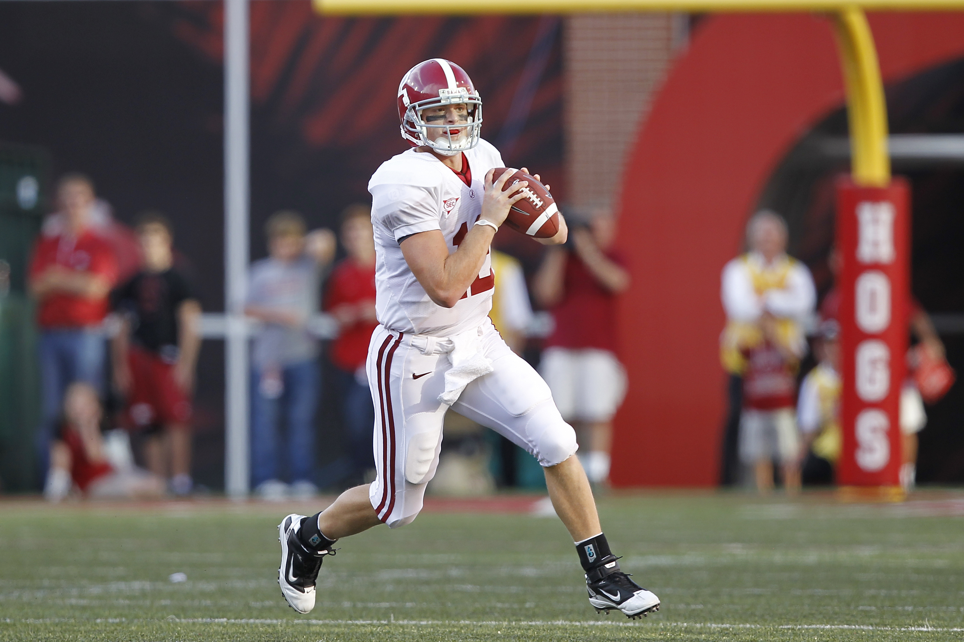 FAYETTEVILLE - SEPTEMBER 25: Greg McElroy #12 of the Alabama Crimson Tide looks to pass against the Arkansas Razorbacks at Donald W. Reynolds Razorback Stadium on September 25, 2010 in Fayetteville, Arkansas. Alabama won 24-20. (Photo by Joe Robbins/Getty