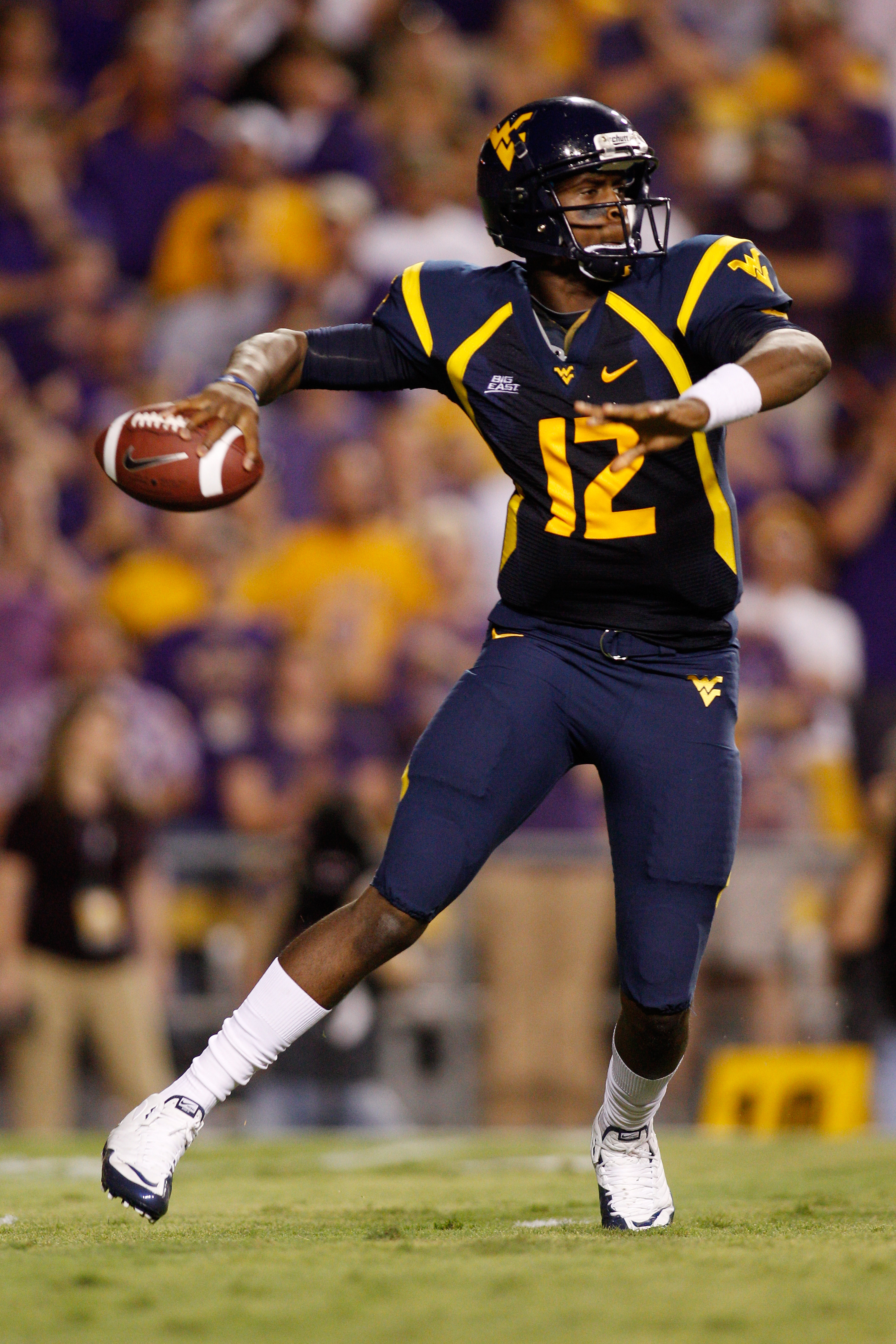 BATON ROUGE, LA - SEPTEMBER 25:  Quarterback Geno Smith #12 of the West Virginia Mountaineers looks to throw a pass against the Louisiana State University Tigers at Tiger Stadium on September 25, 2010 in Baton Rouge, Louisiana.  (Photo by Chris Graythen/G