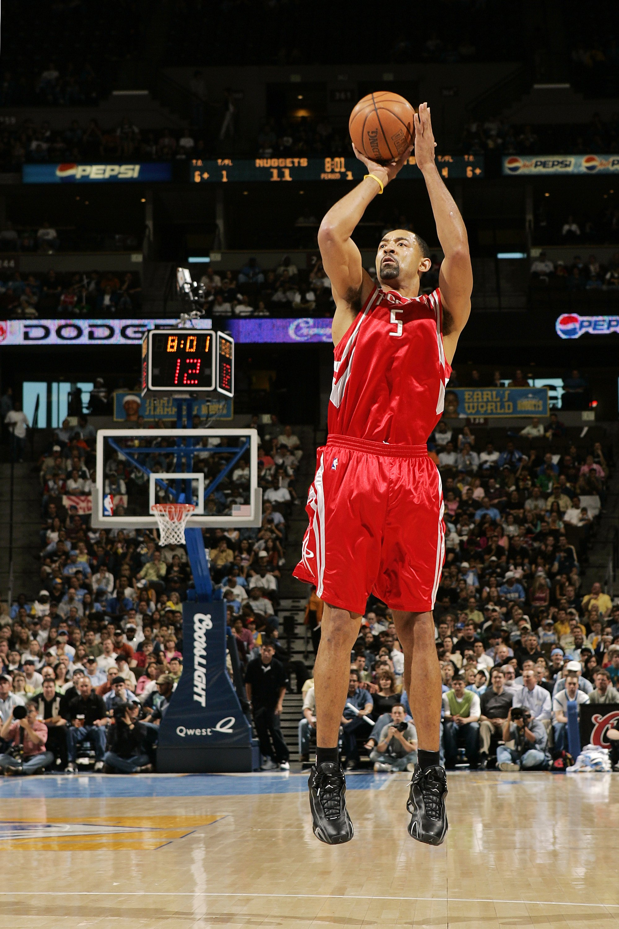 DENVER - APRIL 17:  Juwon Howard #5 of the Houston Rockets shoots against the Denver Nuggets in the first quarter on April 17, 2006 at the Pepsi Center in Denver, Colorado. Howard led with 31 points in the Rockets' 86-83 win.  NOTE TO USER: USER expressly