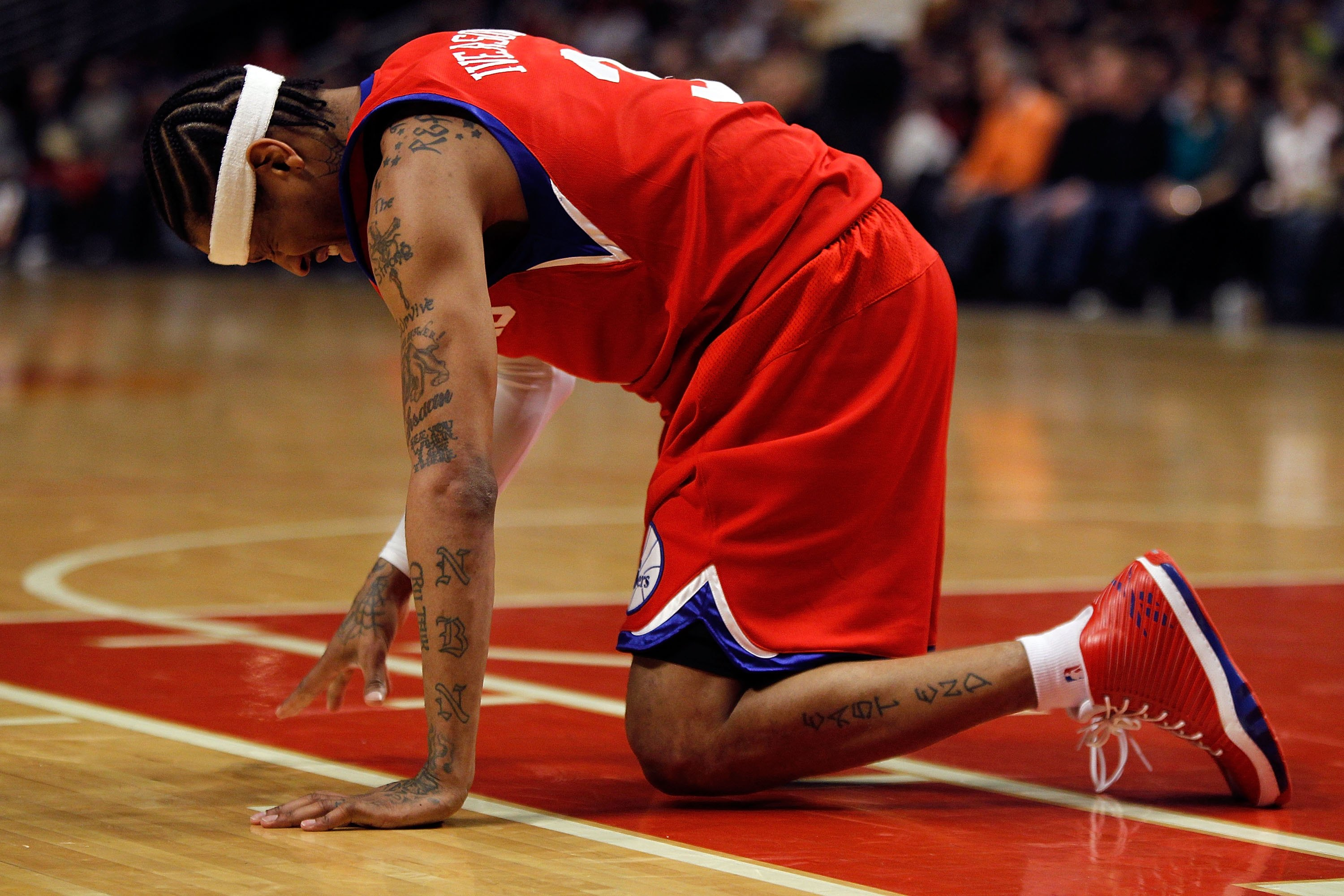 CHICAGO - FEBRUARY 20: Allen Iverson #3 of the Philadelphia 76ers is slow to get up after being hit in the face during a game against the Chicago Bulls at the United Center on February 20, 2010 in Chicago, Illinois. The Bulls defeated the 76ers 122-90. NO