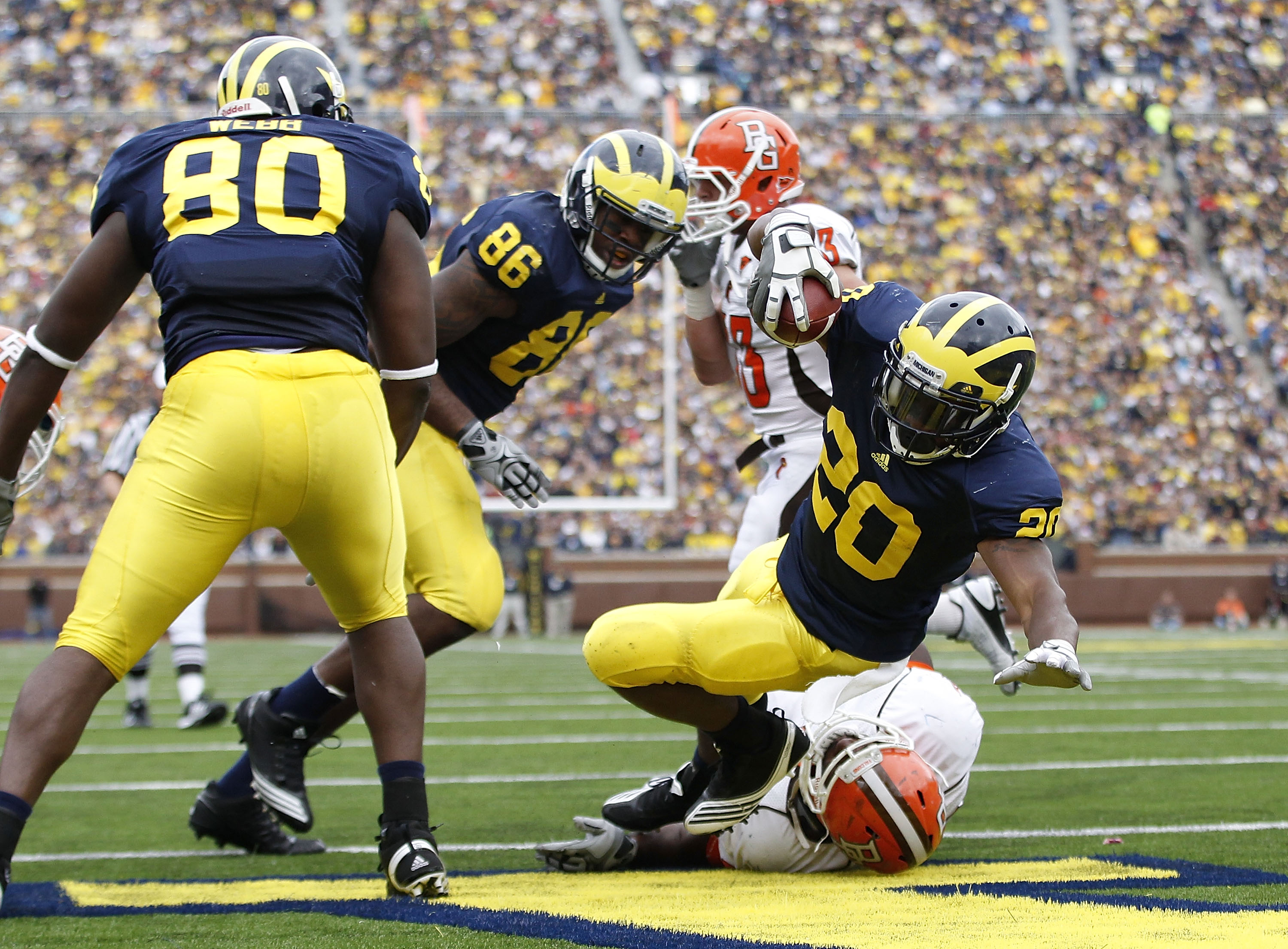 ANN ARBOR, MI - SEPTEMBER 25:  Michael Shaw #20 of the Michigan Wolverines runs for a second quarter touchdown during the game against Bowling Green on September 25, 2010 at Michigan Stadium in Ann Arbor, Michigan.  (Photo by Leon Halip/Getty Images)