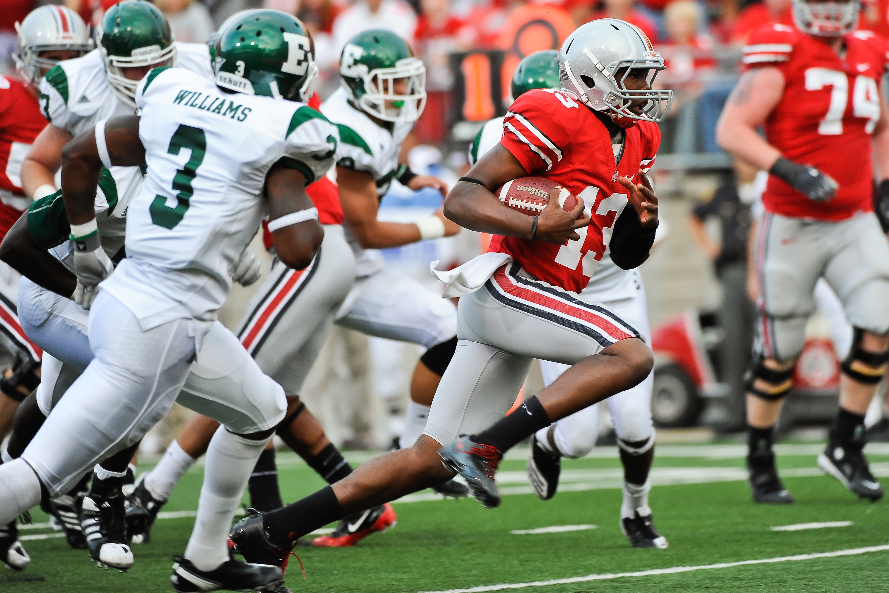 COLUMBUS, OH - SEPTEMBER 25:  Ken Guiton #13 of the Ohio State Buckeyes runs with the ball against the Eastern Michigan Eagles at Ohio Stadium on September 25, 2010 in Columbus, Ohio.  Ohio State won 73-20. (Photo by Jamie Sabau/Getty Images)