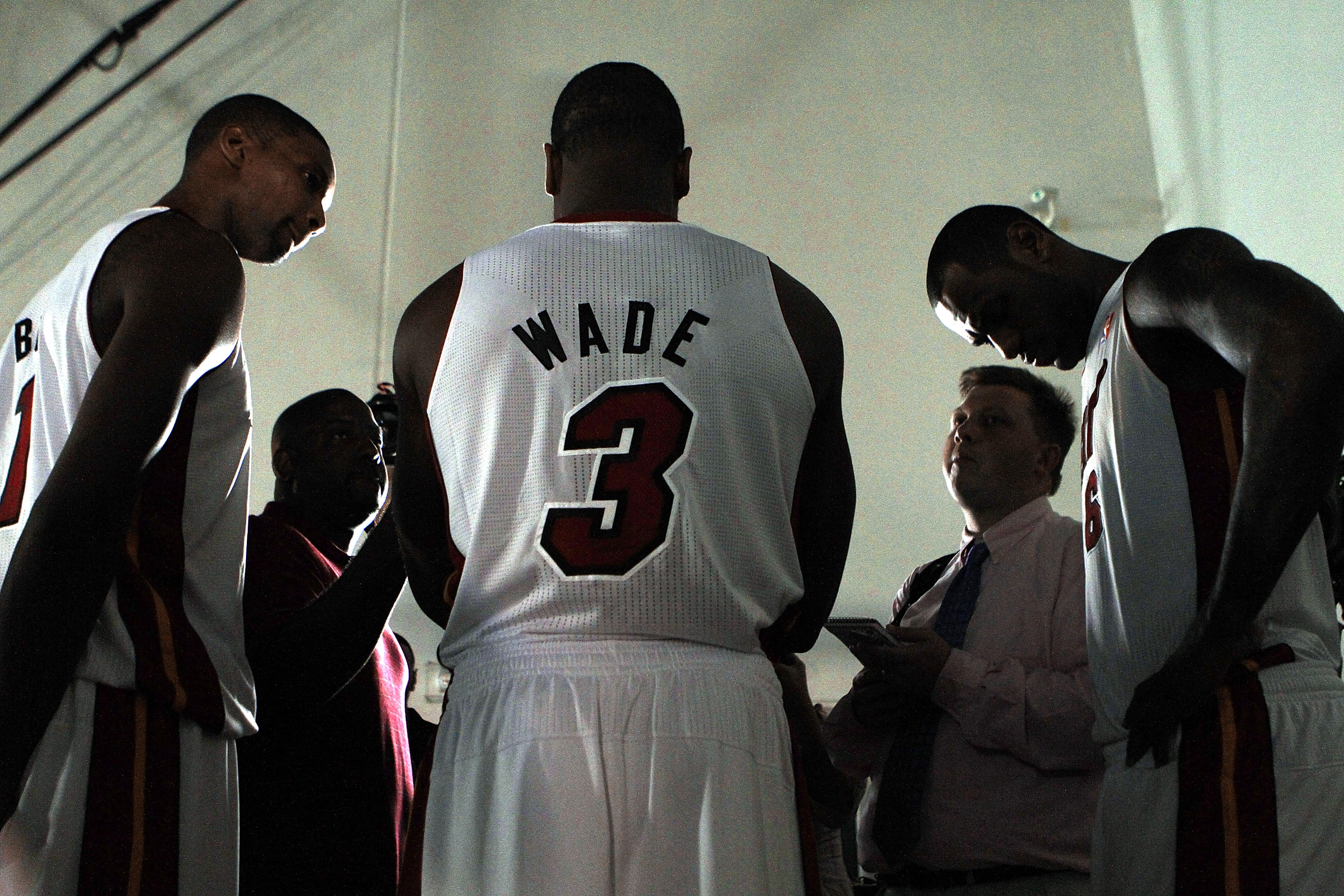 MIAMI - SEPTEMBER 27:  Dwyane Wade (C) of the Miami Heat is flanked by teammates Chris Bosh (L) and LeBron James (R) as they answer questions during media day at the Bank United Center on September 27, 2010 in Miami, Florida. NOTE TO USER: User expressly