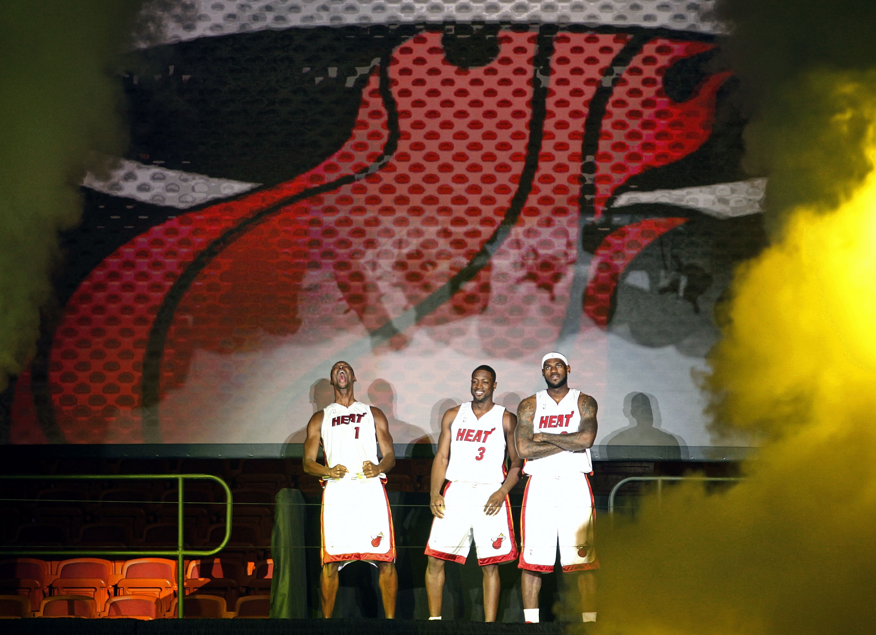 MIAMI - JULY 09:  Fans cheer as (L-R) Chris Bosh #1, Dwyane Wade #3, and LeBron James #6 of the Miami Heat are introduced during a welcome party at American Airlines Arena on July 9, 2010 in Miami, Florida.  (Photo by Marc Serota/Getty Images)
