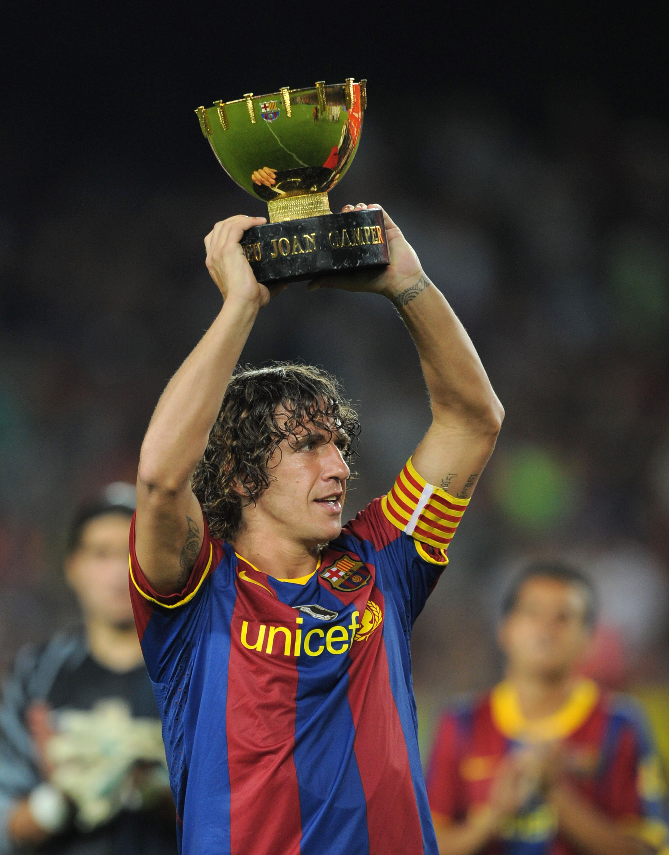 BARCELONA, SPAIN - AUGUST 25:  Carles Puyol of Barcelona holds the Joan Gamper Trophy after his team beat AC Milan in the Joan Gamper Trophy match between Barcelona and AC Milan at Camp Nou stadium on August 25, 2010 in Barcelona, Spain.  (Photo by Denis