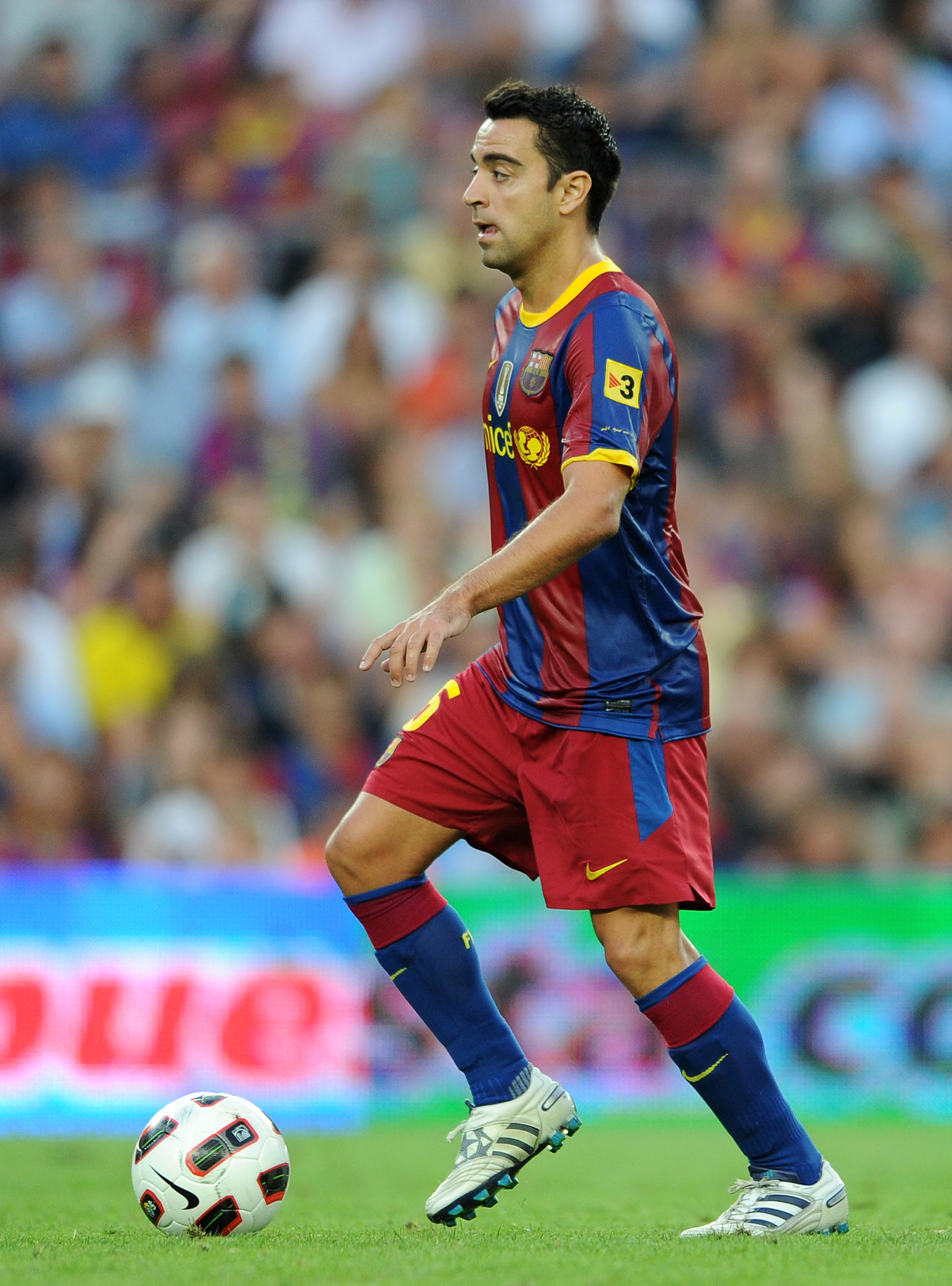 BARCELONA, SPAIN - SEPTEMBER 11:  Xavier Hernandez of Barcelona controls the ball during the La Liga match between Barcelona and Hercules at the Camp Nou stadium on September 11, 2010 in Barcelona, Spain. Barcelona lost the match 2-0.  (Photo by Jasper Ju