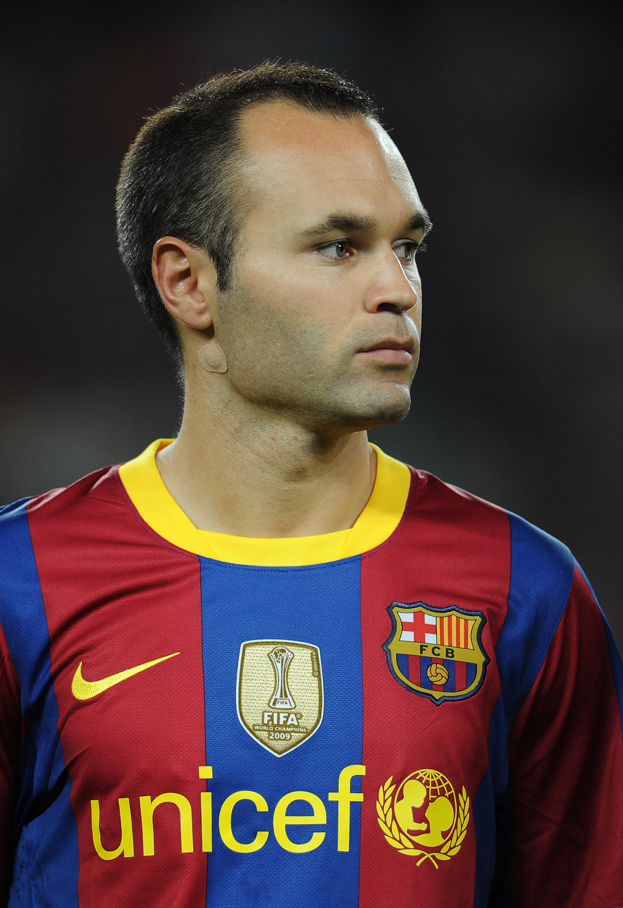 BARCELONA, SPAIN - SEPTEMBER 14:  Andres Iniesta of Barcelona watches on prior to the start of the UEFA Champions League group D match between Barcelona and Panathinaikos on September 14, 2010 in Barcelona, Spain. Barcelona won the match 5-1.  (Photo by J