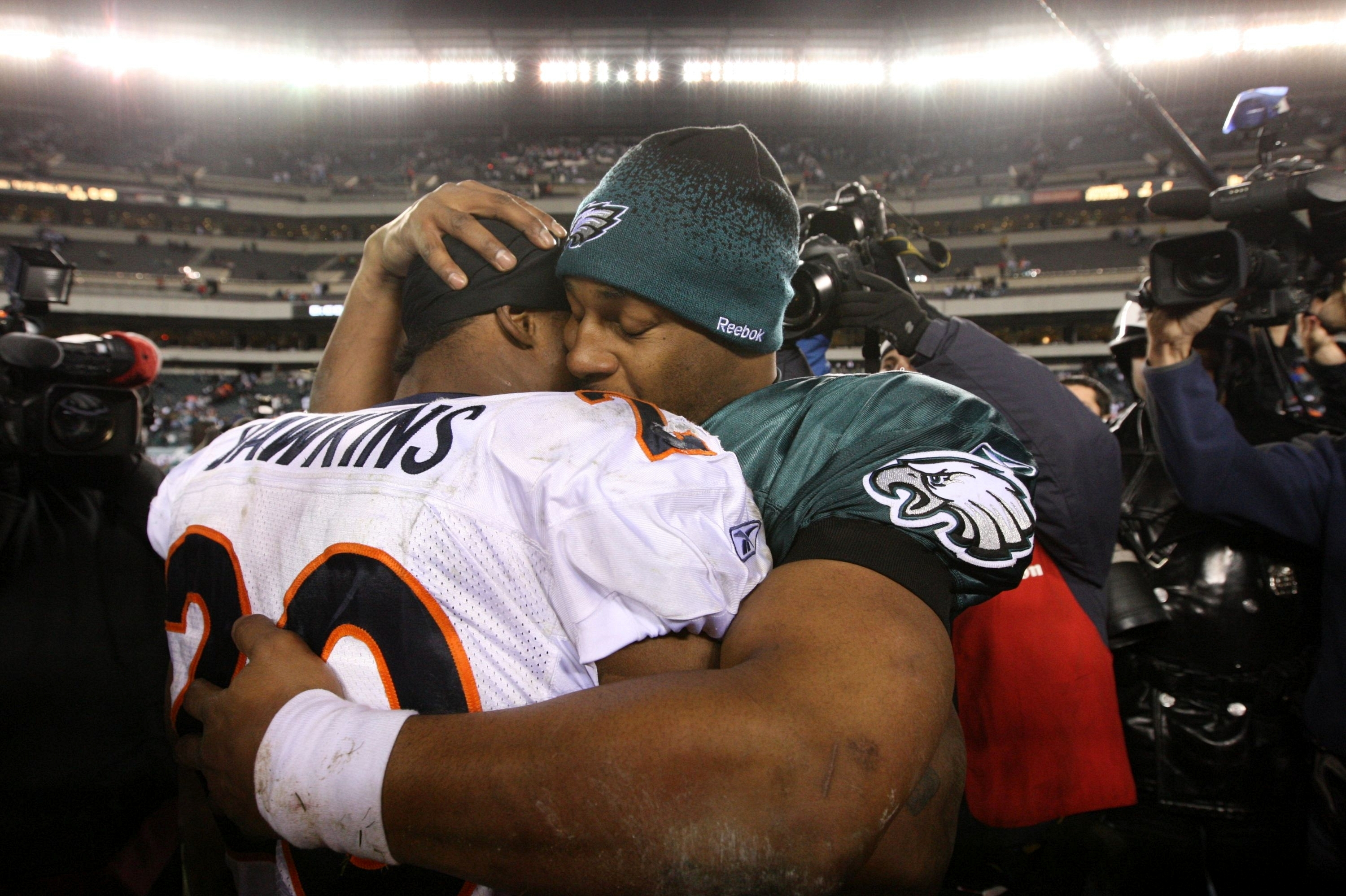 PHILADELPHIA - DECEMBER 27 : Donovan McNabb #5 of the Philadelphia Eagles hugs Brian Dawkins #20 of the Denver Broncos after the game at Lincoln Financial Field on December 27, 2009 in Philadelphia, Pennsylvania. The Broncos were defeated by the Eagles wi