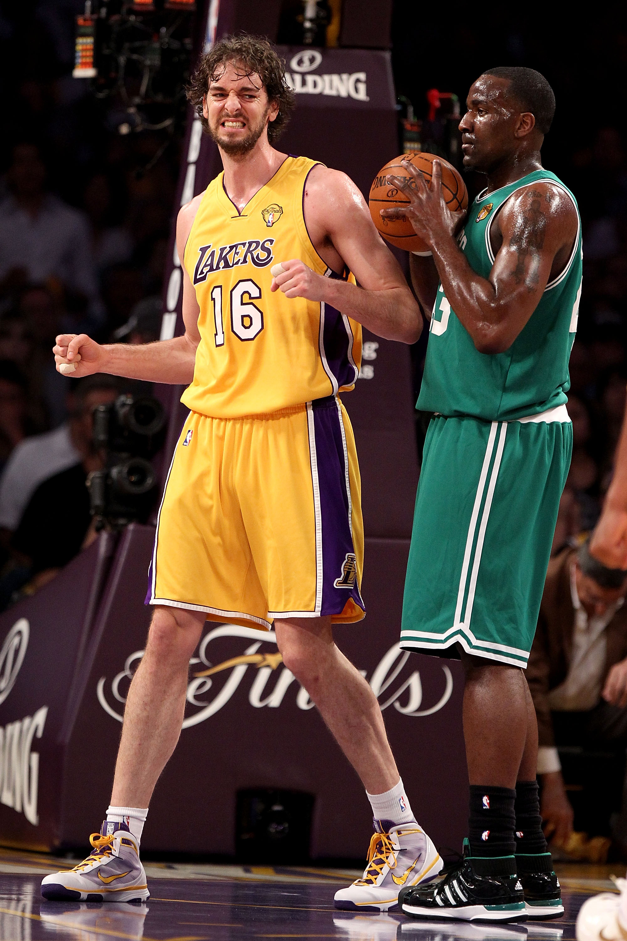 LOS ANGELES, CA - JUNE 15:  Pau Gasol #16 of the Los Angeles Lakers reacts alongside Kendrick Perkins #43 of the Boston Celtics in the first period of Game Six of the 2010 NBA Finals at Staples Center on June 15, 2010 in Los Angeles, California.  NOTE TO