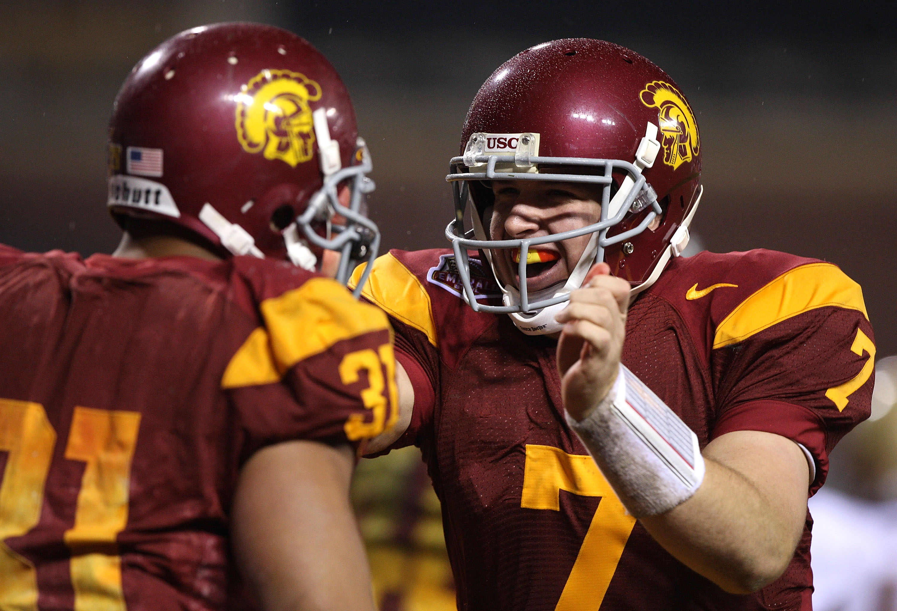 SAN FRANCISCO - DECEMBER 26: Matt Barkley #7 of the USC Trojans celebrates with Stanley Havili #31 after scoring a touchdown in the second quarter against the Boston College Eagles during the 2009 Emerald Bowl at AT&T Park on December 26, 2009 in San Fran