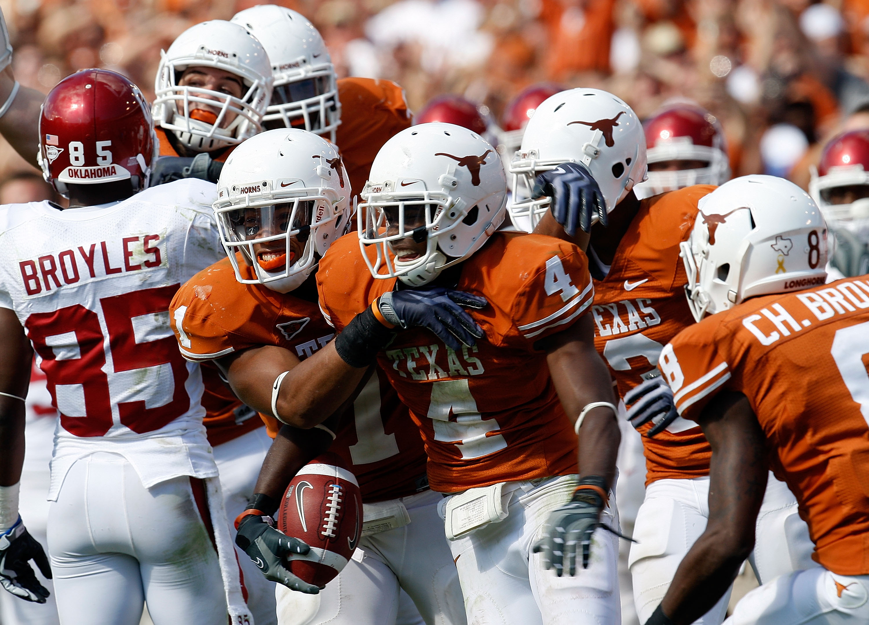 DALLAS - OCTOBER 17:  Defensive back Aaron Williams #4 of the Texas Longhorns celebrates a pass interception with Deon Beasley against the Oklahoma Sooners at Cotton Bowl on October 17, 2009 in Dallas, Texas.  (Photo by Ronald Martinez/Getty Images)