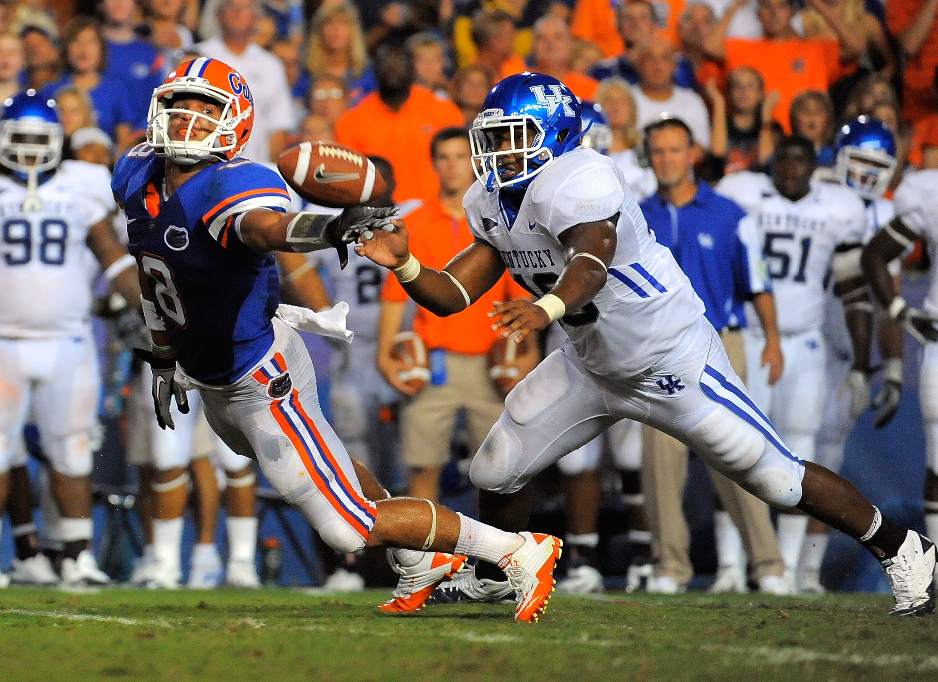 GAINESVILLE, FL - SEPTEMBER 25:  Half back Trey Burton #8 of the Florida Gators can't hang onto a pass in front of linebacker Ridge Wilson #48 of the Kentucky Wildcats at Ben Hill Griffin Stadium on September 25, 2010 in Gainesville, Florida.  (Photo by D