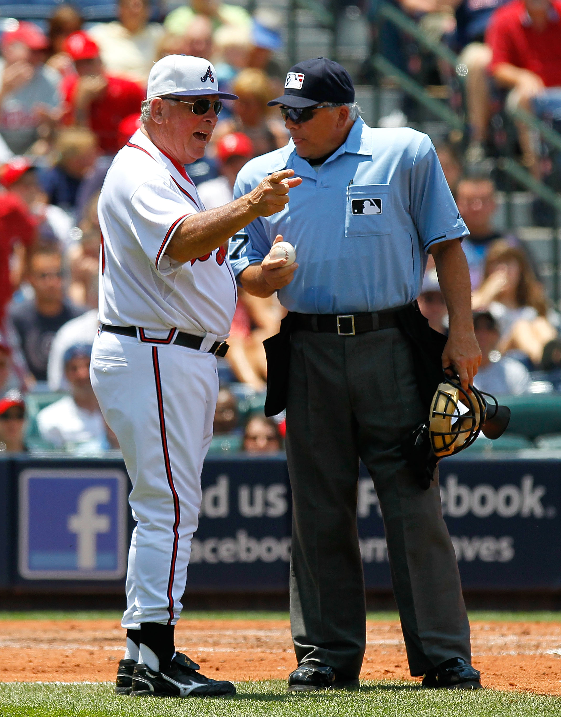 ATLANTA - MAY 31:  Manager Bobby Cox #6 of the Atlanta Braves argues a call with homeplate umpire Larry Vanover #27 in the third inning against the Philadelphia Phillies at Turner Field on May 31, 2010 in Atlanta, Georgia.  (Photo by Kevin C. Cox/Getty Im