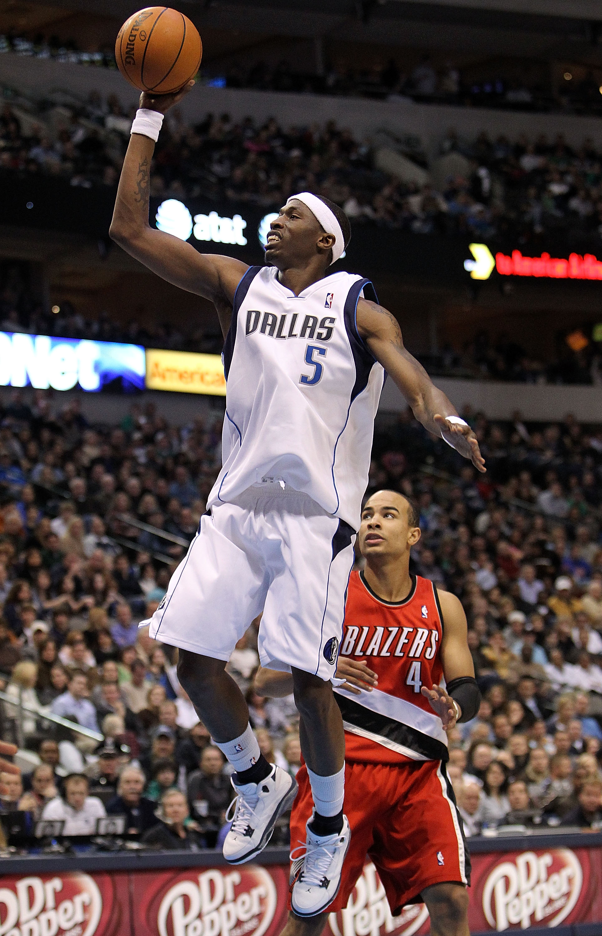 DALLAS - JANUARY 30:  Forward Josh Howard #5 of the Dallas Mavericks takes a shot against Jerryd Bayless #4 of the Portland Trail Blazers on January 30, 2010 at American Airlines Center in Dallas, Texas.  NOTE TO USER: User expressly acknowledges and agre