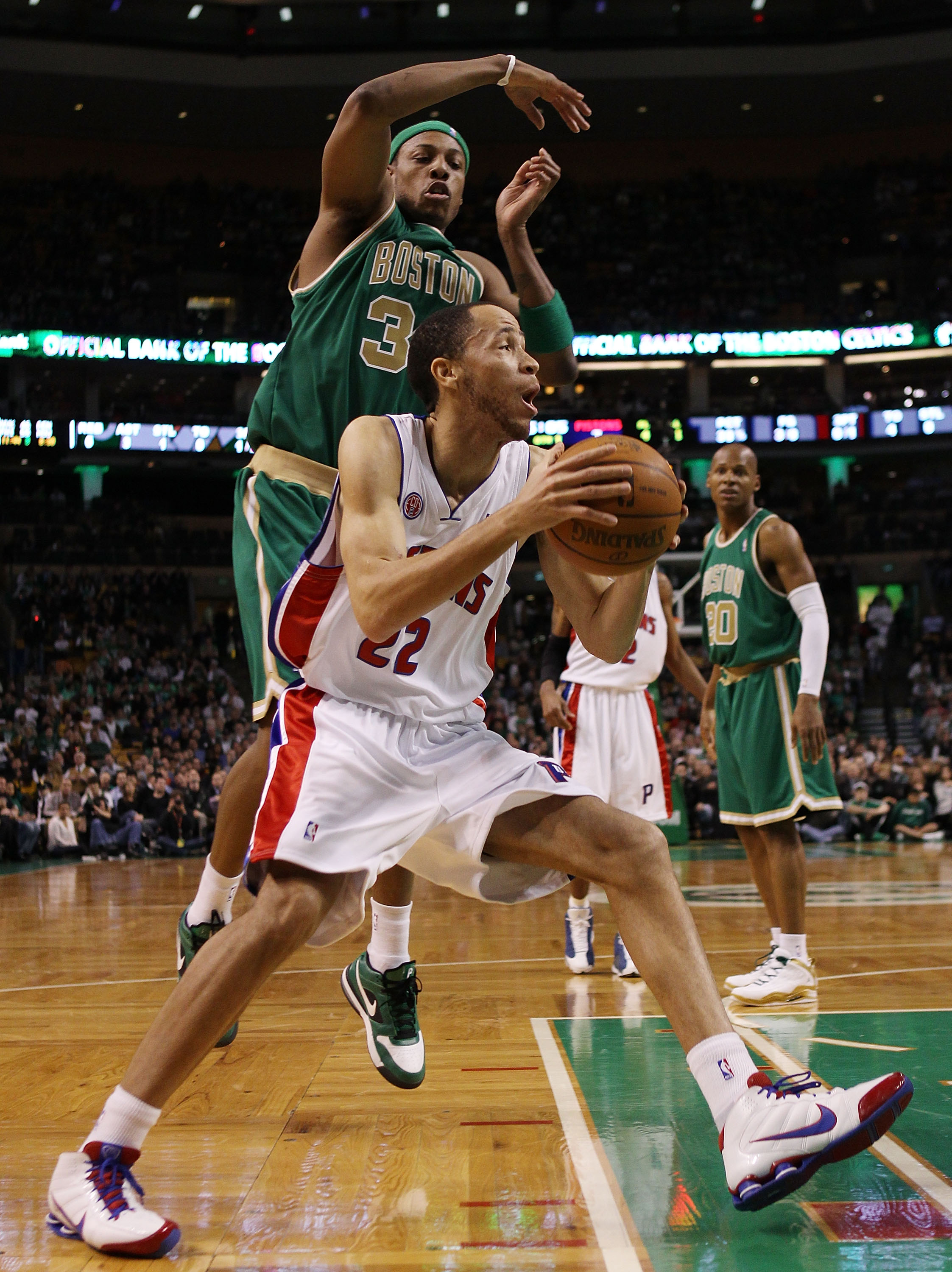 BOSTON - MARCH 15:  Tayshaun Prince #22 of the Detroit Pistons heads for the net as Paul Pierce #34 of the Boston Celtics defends on March 15, 2010 at the TD Garden in Boston, Massachusetts.  NOTE TO USER: User expressly acknowledges and agrees that, by d